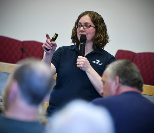 Minnesota Department of Agriculture plant health specialist Jennifer Burington answers questions about the emerald ash borer Thursday, May 9, at the Sauk Centre City Hall.