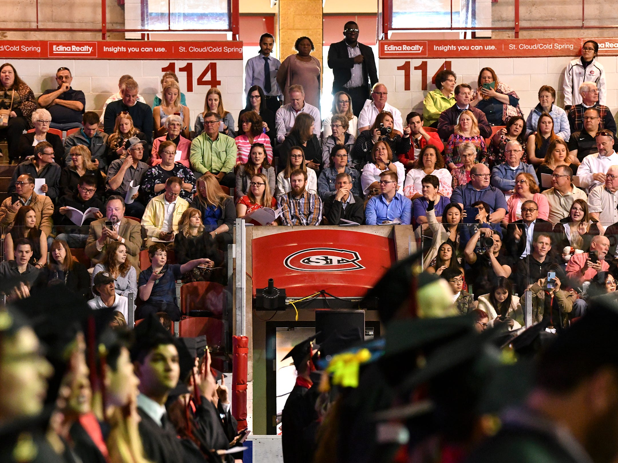 Friends and family watch as students enter for the morning commencement ceremony Friday, May 10, in the Herb Brooks National Hockey Center at St. Cloud State University in St. Cloud.