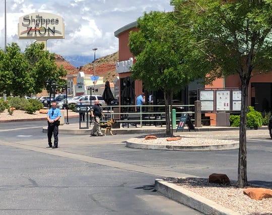 Police investigate the scene around a Starbucks coffee shop in St. George after reports of a bomb threat on Friday, May 10, 2019.