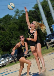 Lincoln seniors Daelynn Shoaf and Amber Grant (2) helps Lincoln to a 15-2 record and a spot in the finals of the high school beach volleyball championships at Tom Brown Park on May 7 and 9, 2019.