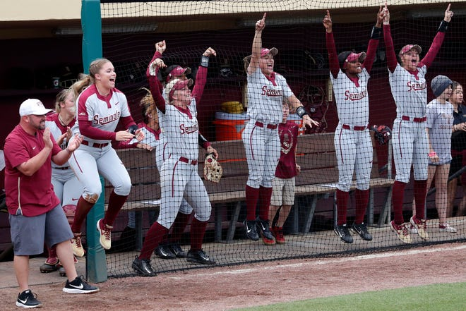 Florida State Seminoles cheer in the dug out as they host the Notre Dame Fighting Irish for the ACC Softball Tournament semifinals Friday, May 10, 2019.