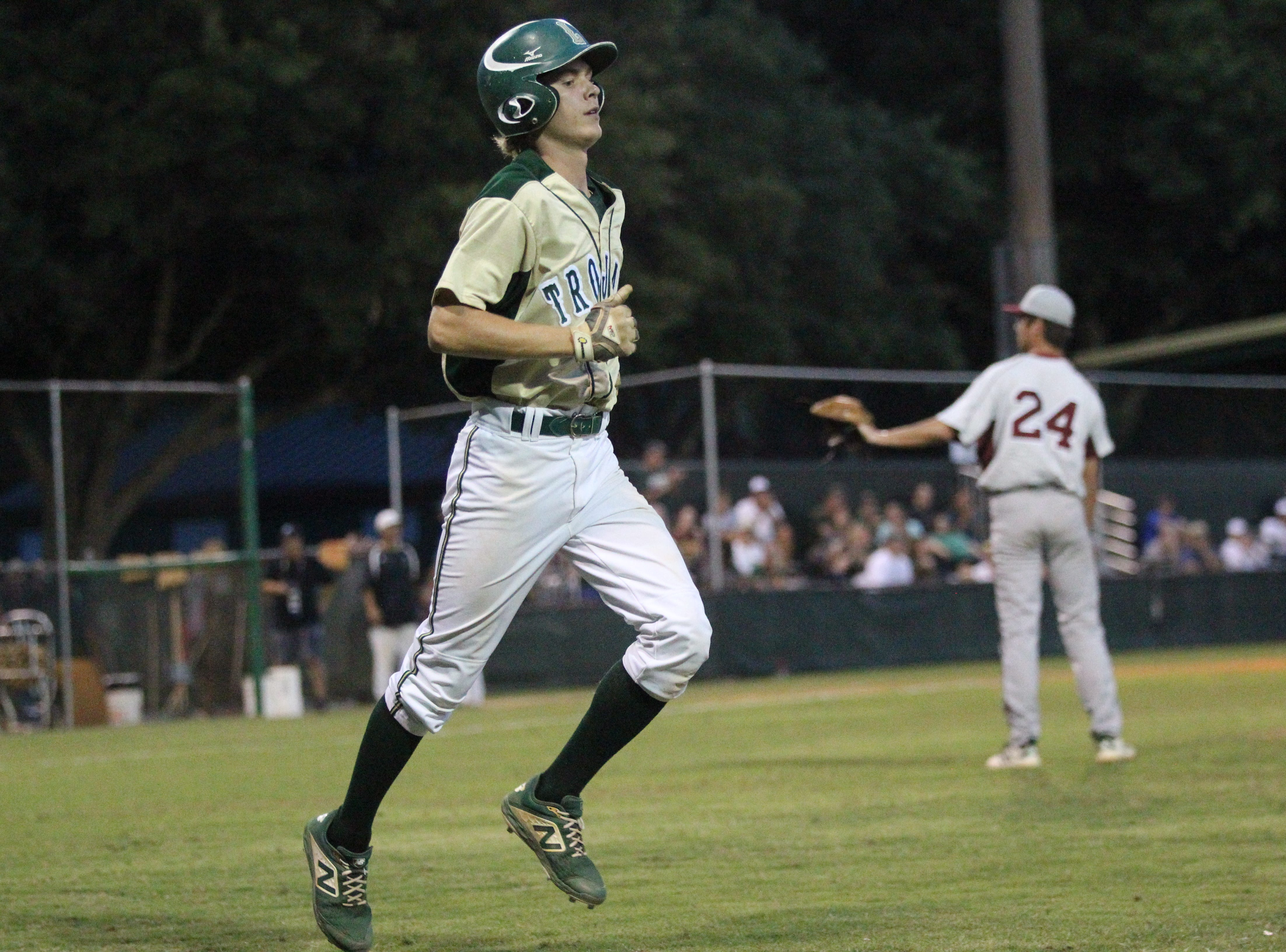 Lincoln senior Nick Standridge takes a walk as Lincoln baseball beat Chiles 5-4  in 10 innings during a District 2-8A championship game on Thursday, May 9, 2019.