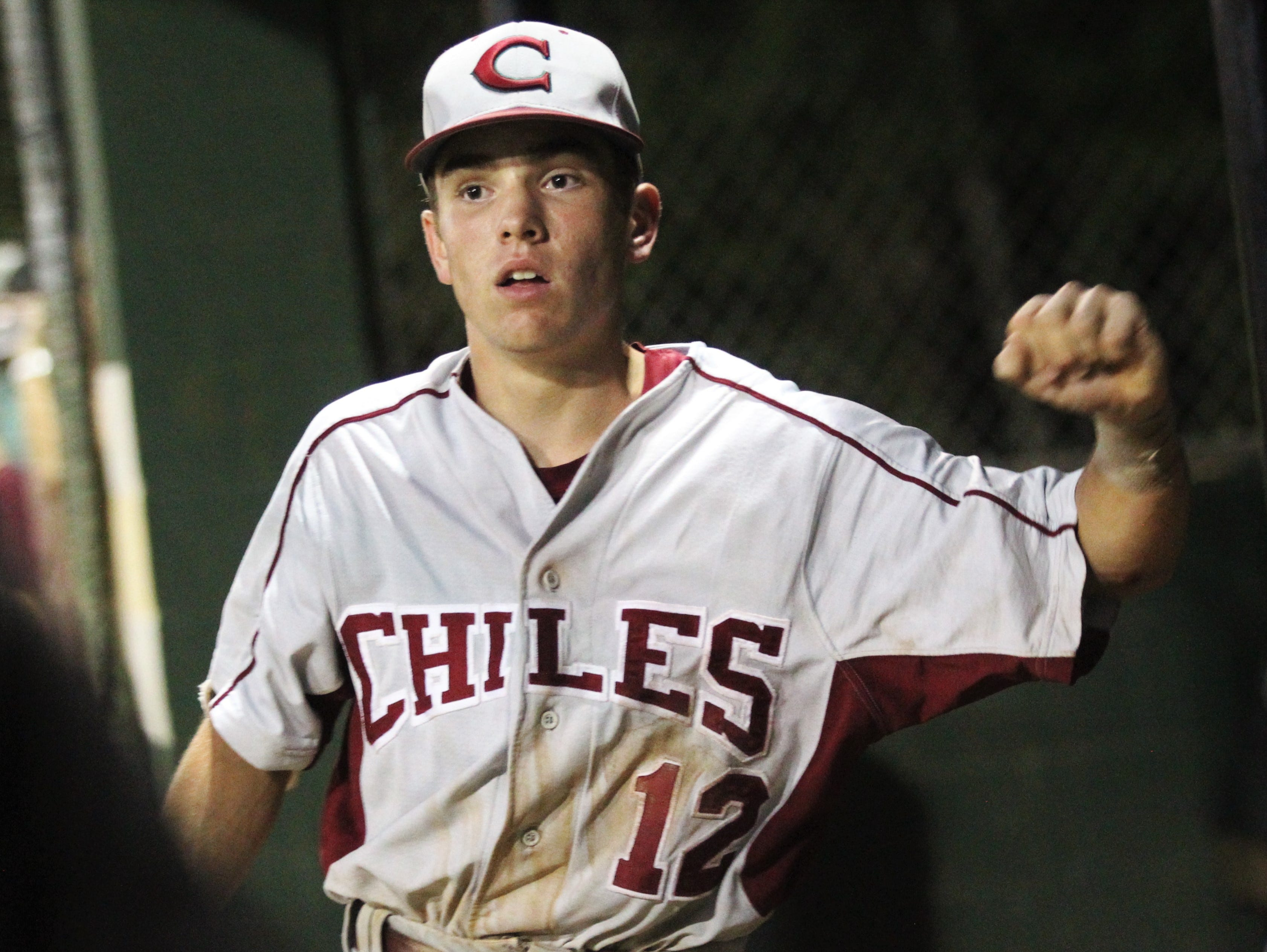 Chiles freshman Jaxson West reacts in the dugout after hitting a sac fly as Lincoln baseball beat Chiles 5-4  in 10 innings during a District 2-8A championship game on Thursday, May 9, 2019.