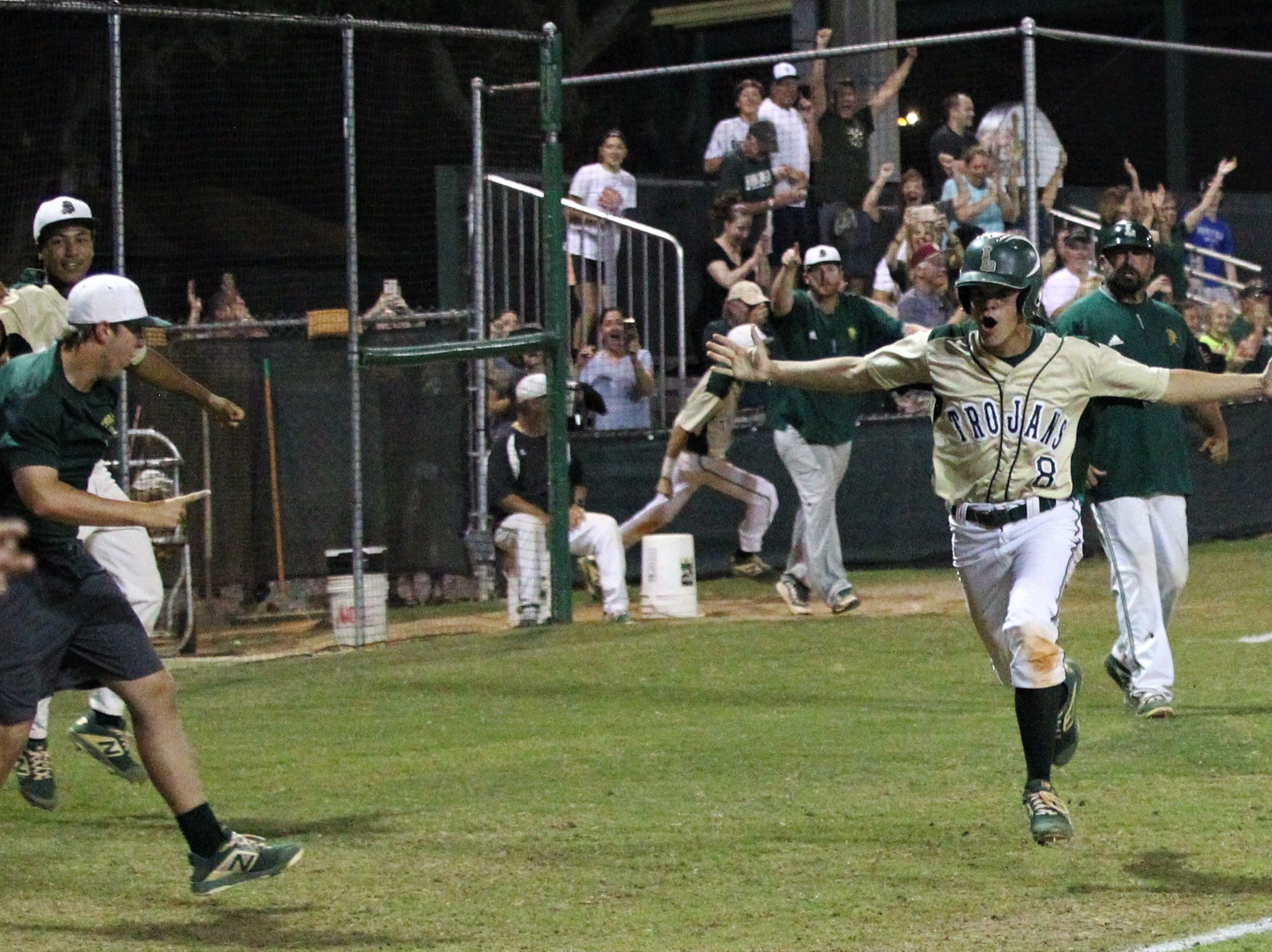 Lincoln junior Jared Edmonston comes in to score on Justin Bradgon's walk-off double as Lincoln baseball beat Chiles 5-4  in 10 innings during a District 2-8A championship game on Thursday, May 9, 2019.