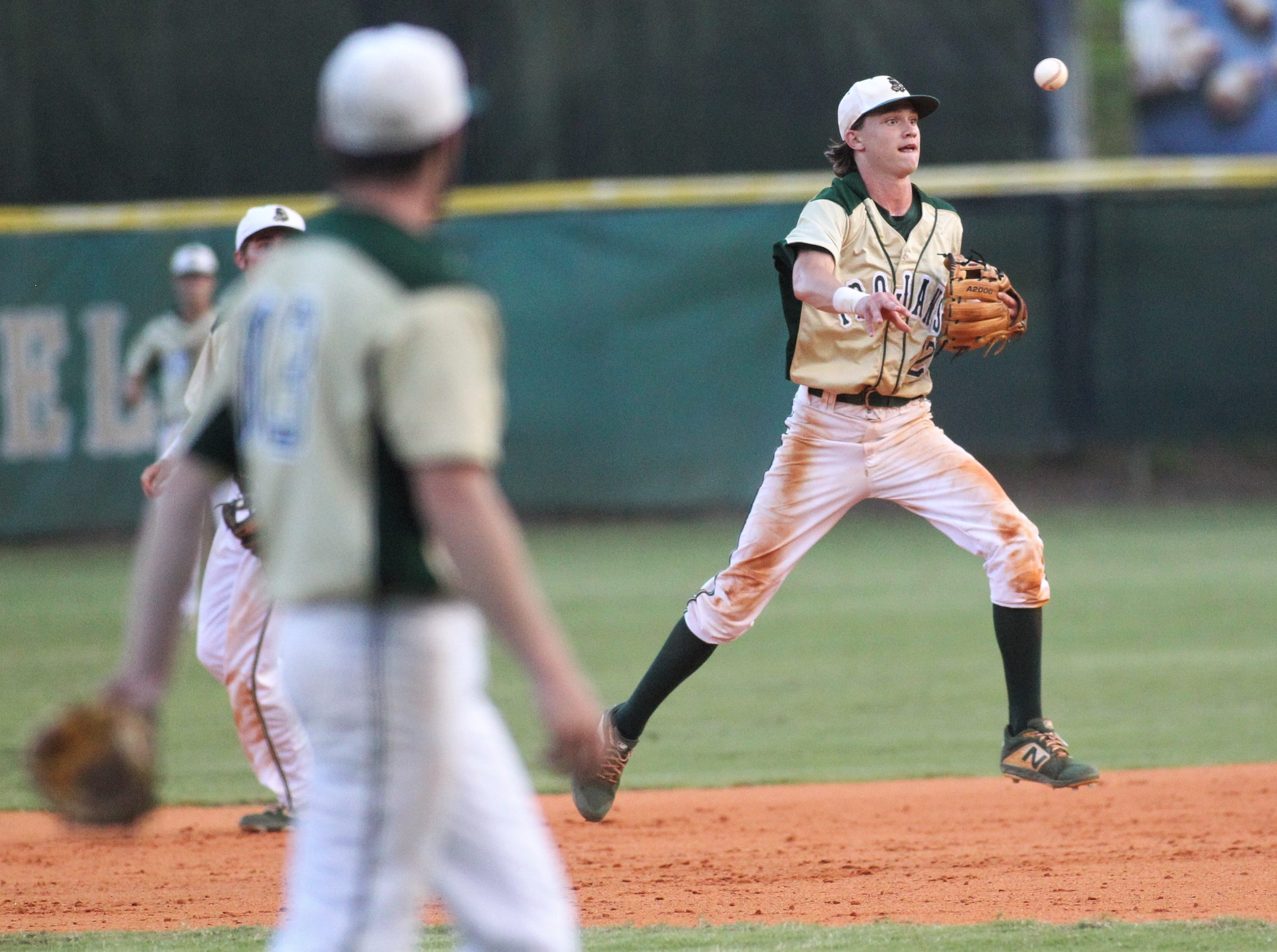 Lincoln shortstop Nick Standridge throws on the run to first for an out as Lincoln baseball beat Chiles 5-4  in 10 innings during a District 2-8A championship game on Thursday, May 9, 2019.