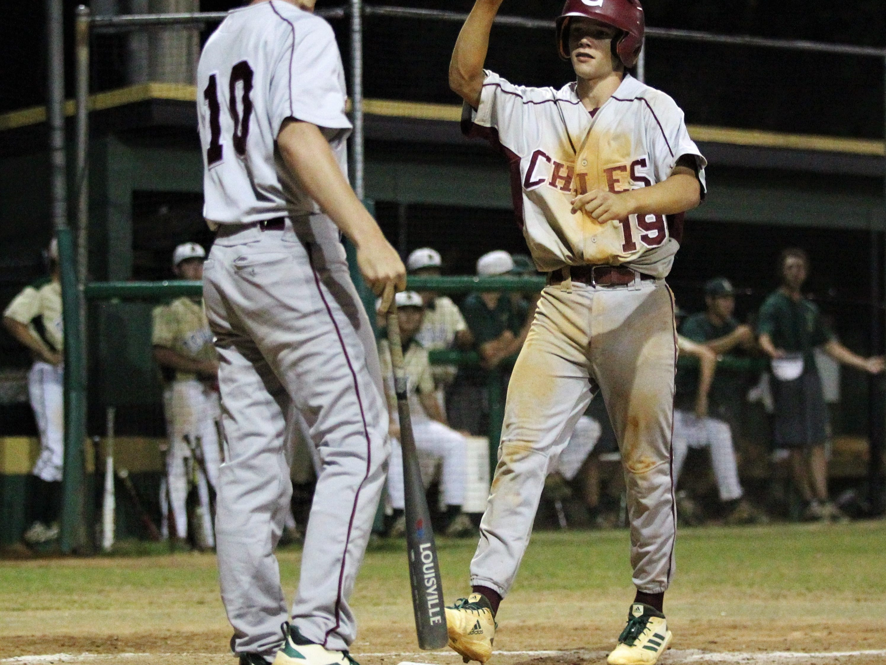 Chiles freshman Parker McDonald scores a go-ahead run on a bases loaded walk as Lincoln baseball beat Chiles 5-4  in 10 innings during a District 2-8A championship game on Thursday, May 9, 2019.