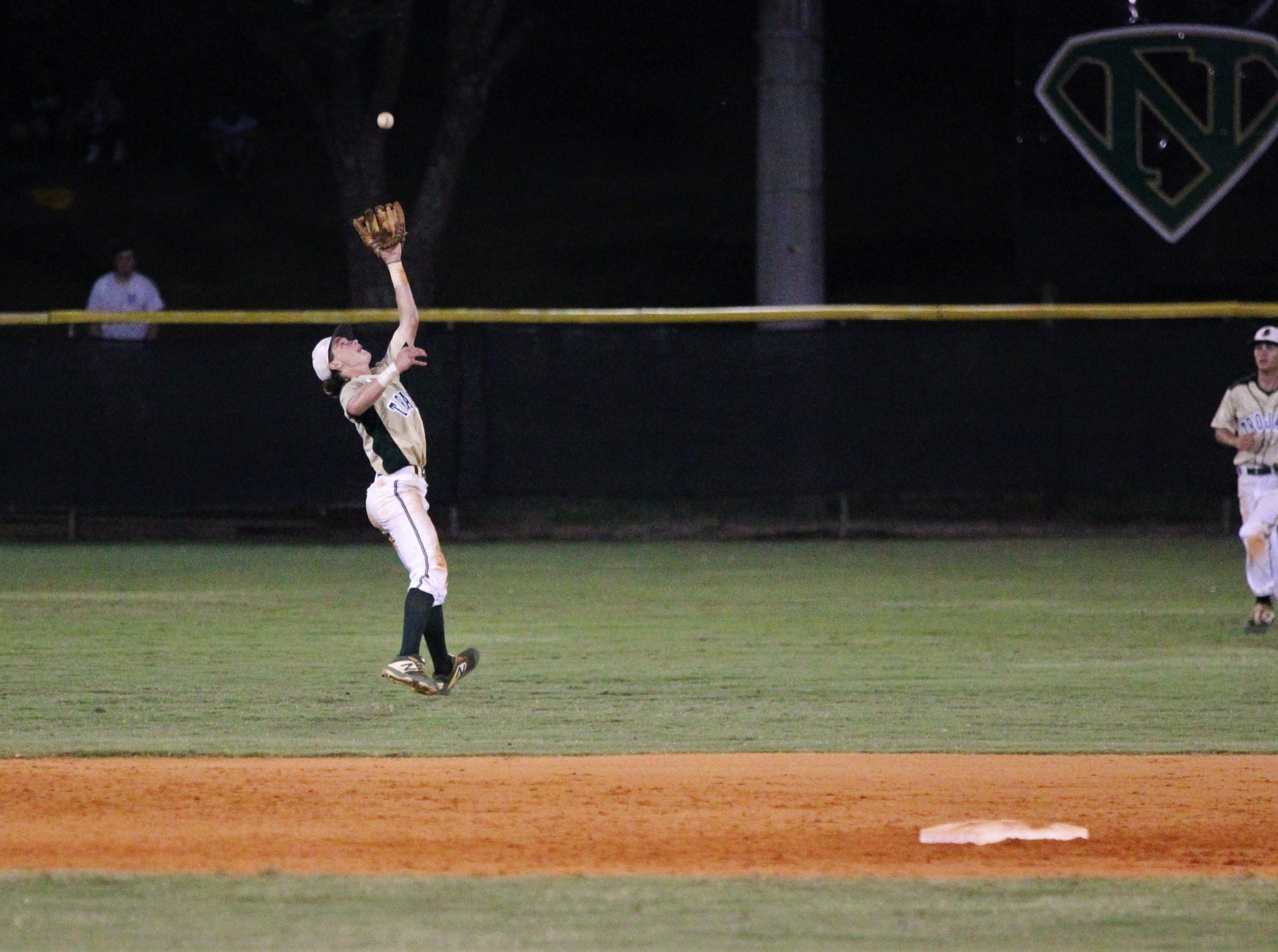 Lincoln shortstop Nick Standridge makes a leaping catch in the shallow outfield as Lincoln baseball beat Chiles 5-4  in 10 innings during a District 2-8A championship game on Thursday, May 9, 2019.