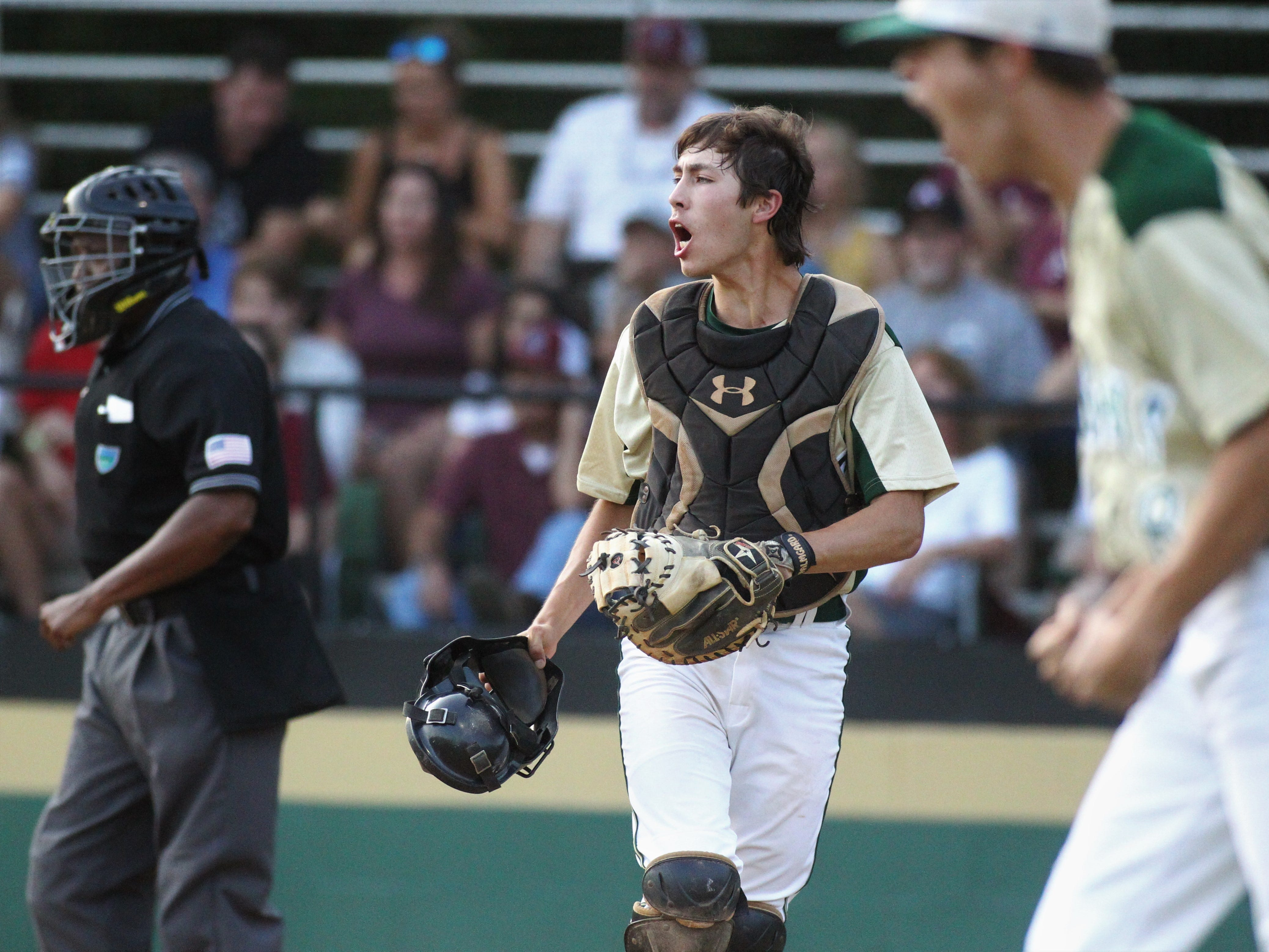 Lincoln catcher Hunter Peschl reacts to an inning-ending out as Lincoln baseball beat Chiles 5-4  in 10 innings during a District 2-8A championship game on Thursday, May 9, 2019.