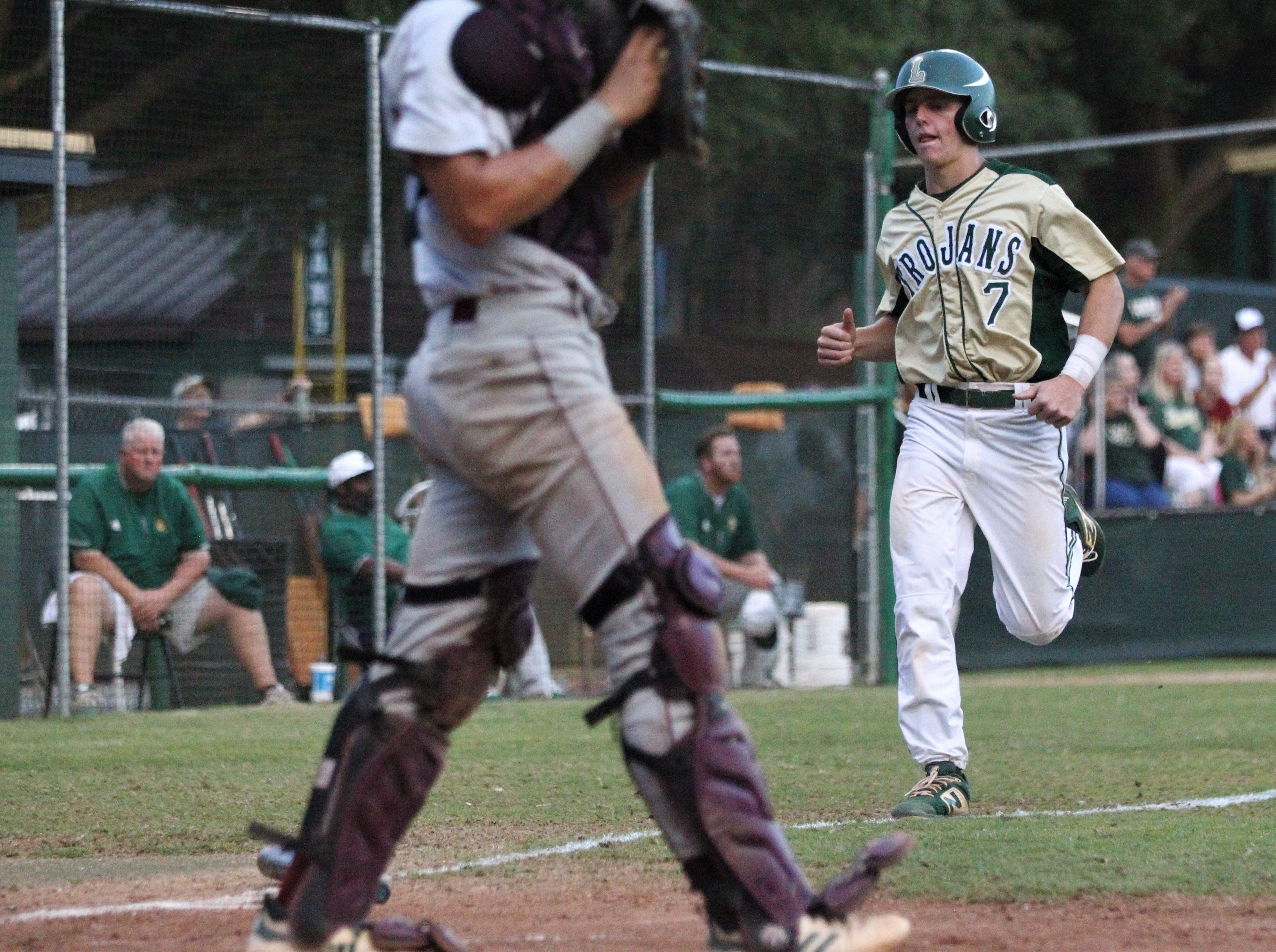 Lincoln junior Justin Bragdon trots home to score a run on a bases-loaded walk as Lincoln baseball beat Chiles 5-4  in 10 innings during a District 2-8A championship game on Thursday, May 9, 2019.