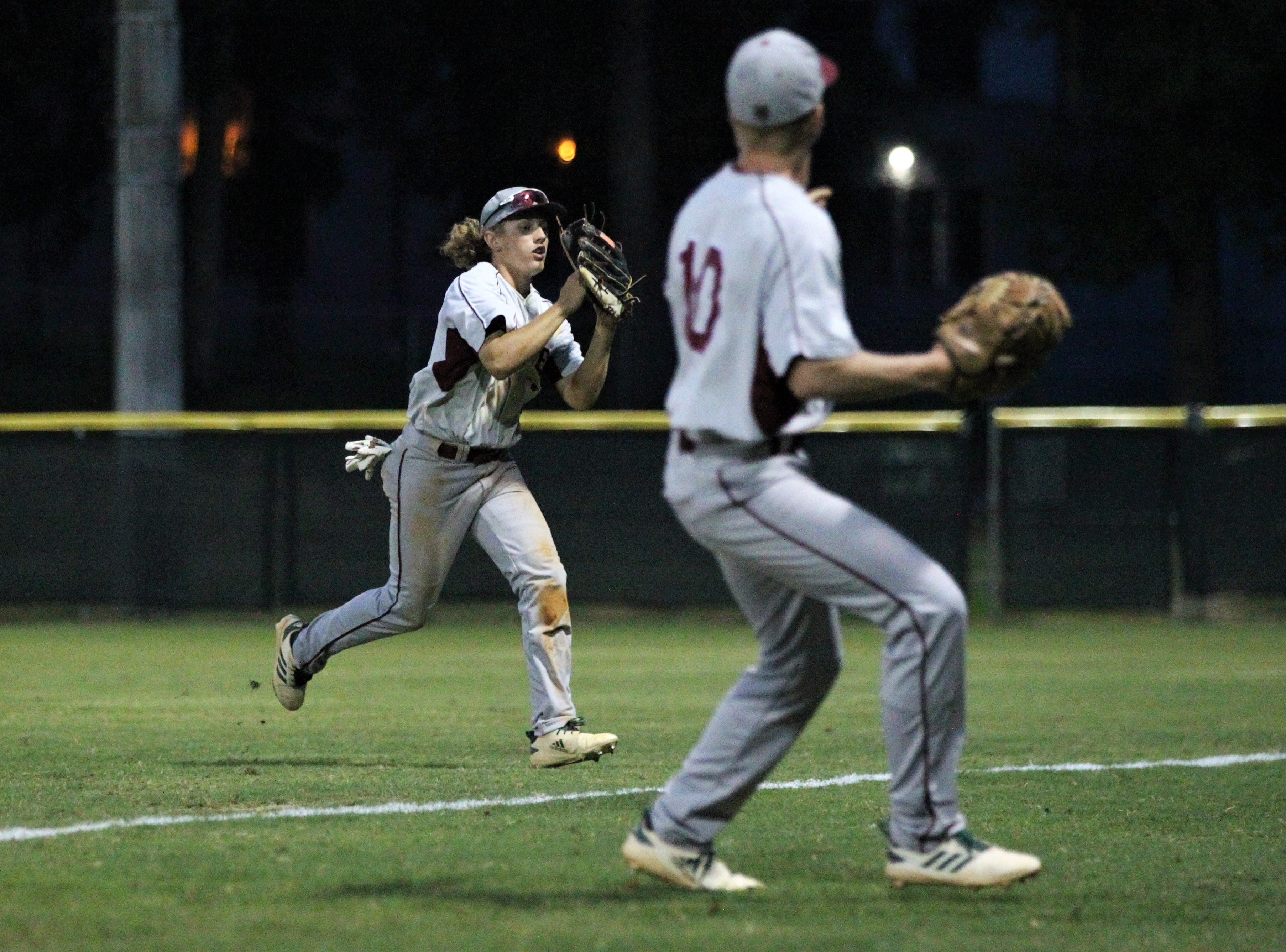 Chiles right fielder Tyler Gerteisen track down a fly ball on the run as Lincoln baseball beat Chiles 5-4  in 10 innings during a District 2-8A championship game on Thursday, May 9, 2019.