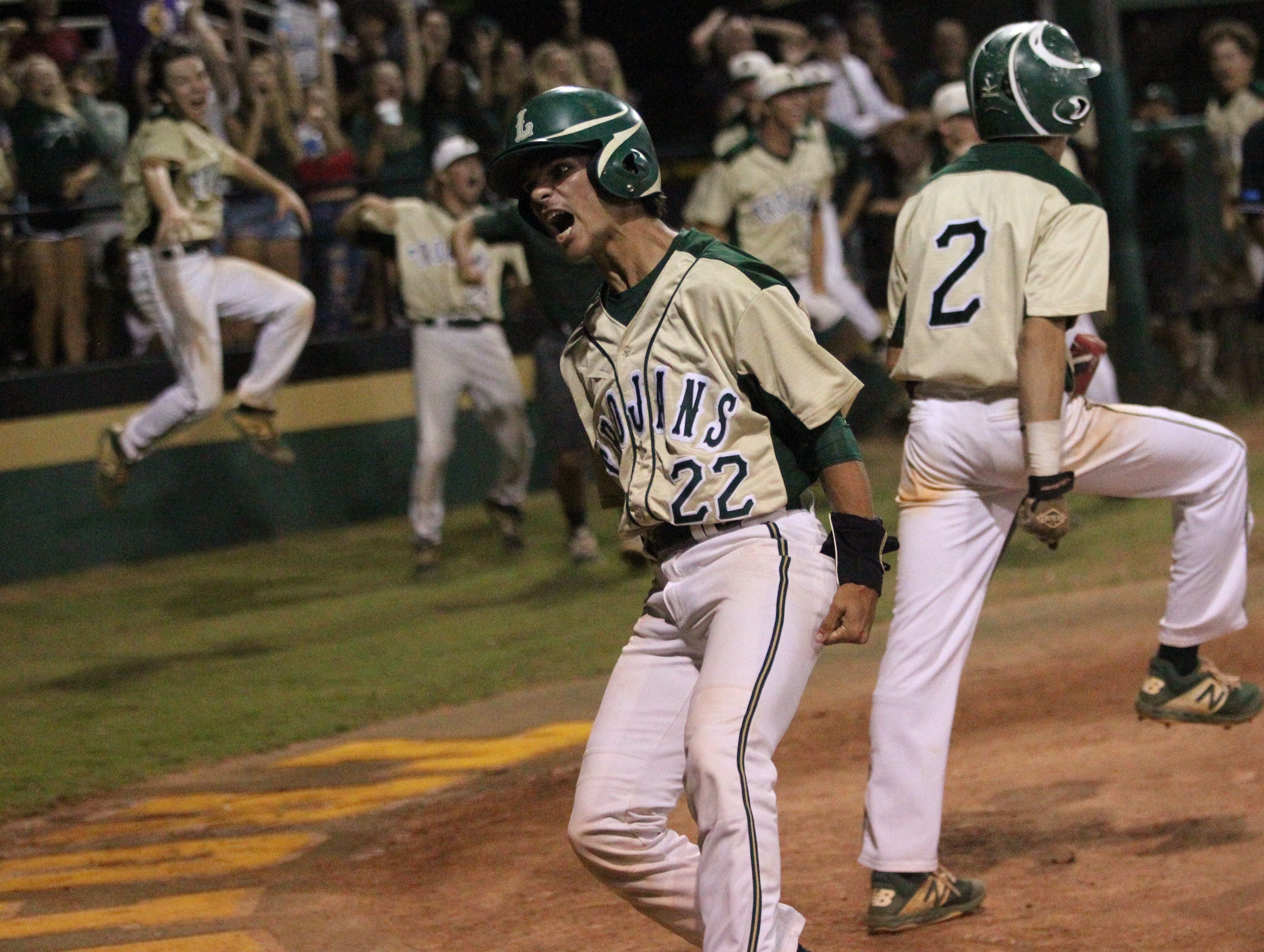 Lincoln's Connor Majors scores the game-tying run in the bottom of the seventh on an error as Lincoln baseball beat Chiles 5-4  in 10 innings during a District 2-8A championship game on Thursday, May 9, 2019.