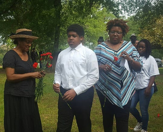Kids erceive flowers to place on graves