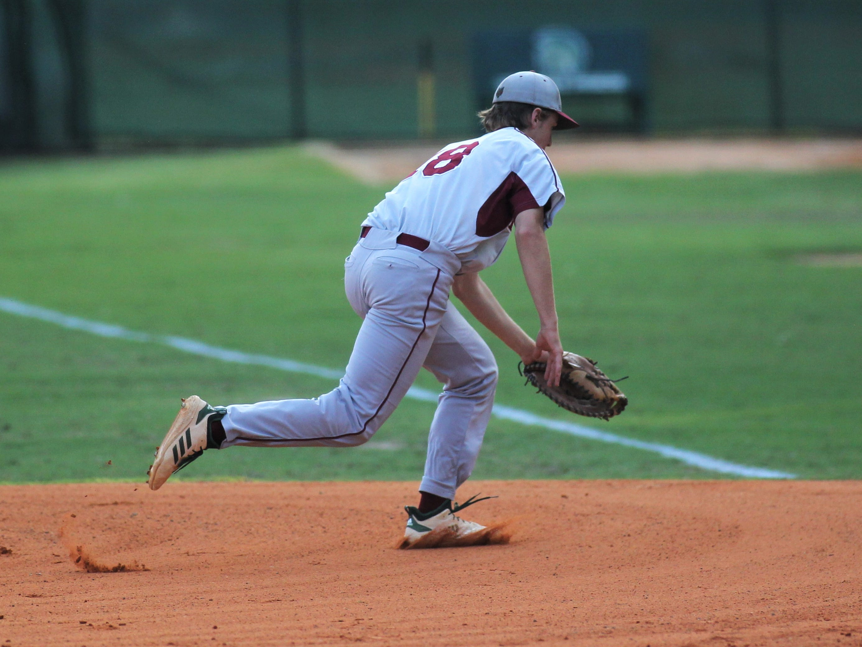 Chiles first baseman William Kilduff has a ball kick away for an error as Lincoln baseball beat Chiles 5-4  in 10 innings during a District 2-8A championship game on Thursday, May 9, 2019.
