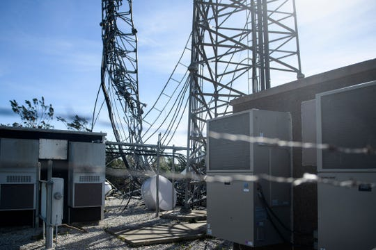 A destroyed cellular tower is seen in the aftermath of Hurricane Michael on October 12, 2018 in Panama City, Florida. - Rescue teams using sniffer dogs carried out a grim search for victims of Hurricane Michael on Friday amid fears that the death toll from the monster storm, which currently stands at 11, could rise.  (Photo credit by BRENDAN SMIALOWSKI/AFP/Getty Images)