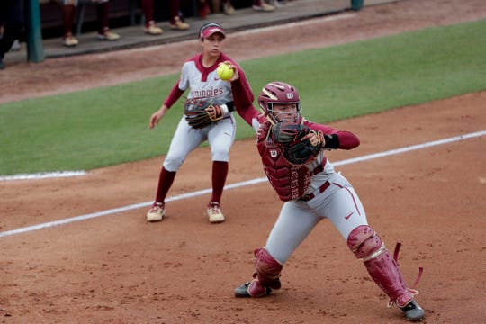 Florida State Seminoles catcher Anna Shelnutt (13) throws to first base.The Florida State Seminoles host the Notre Dame Fighting Irish for the ACC Softball Tournament semifinals Friday, May 10, 2019.