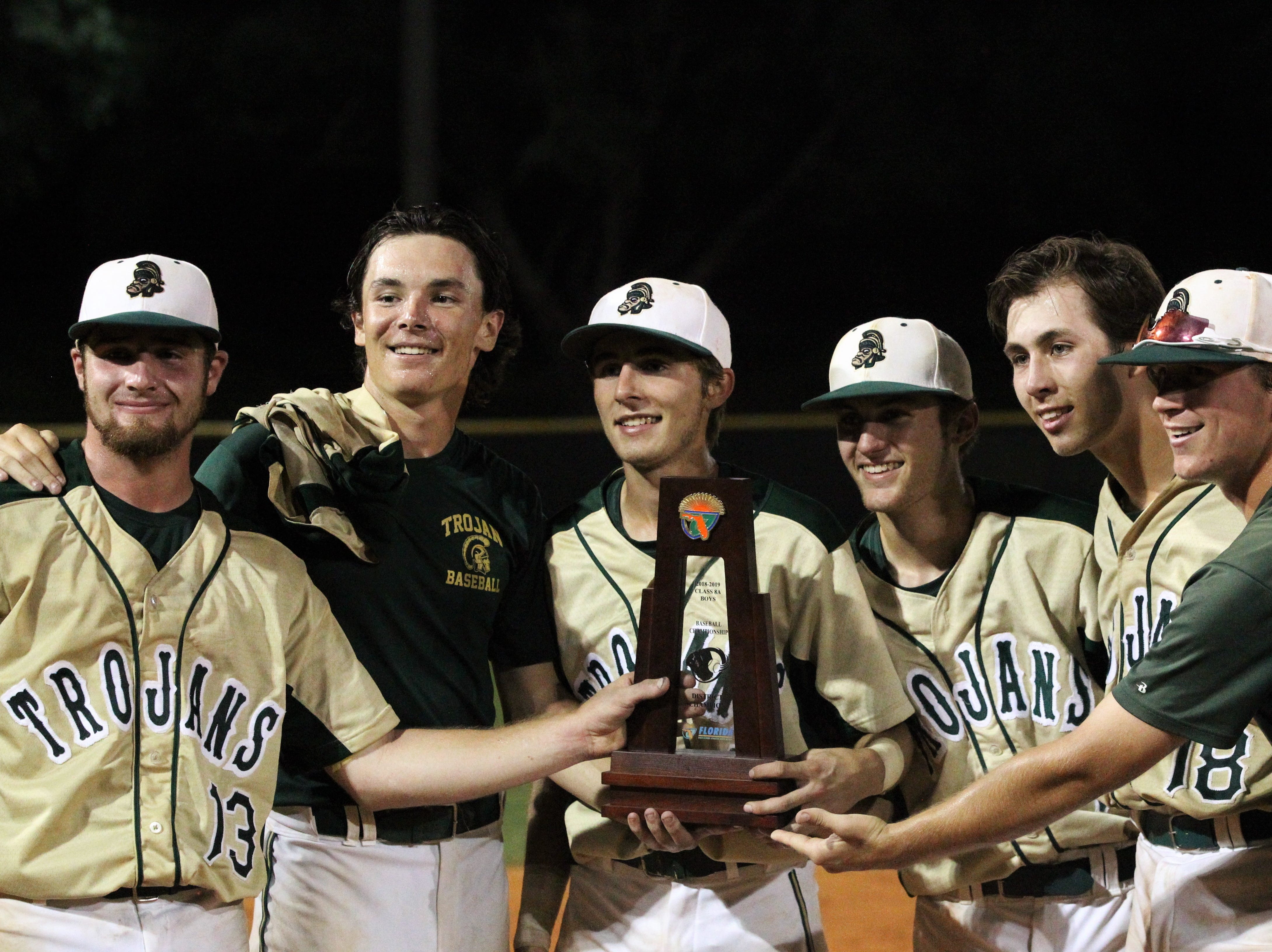 Lincoln seniors Nick Ferrara, Shawn Snyder, Jackson White, Caleb Kittrell, Hunter Peschl and Beau Evans take a photo after the Trojans beat Chiles 5-4  in 10 innings during a District 2-8A championship game on Thursday, May 9, 2019.