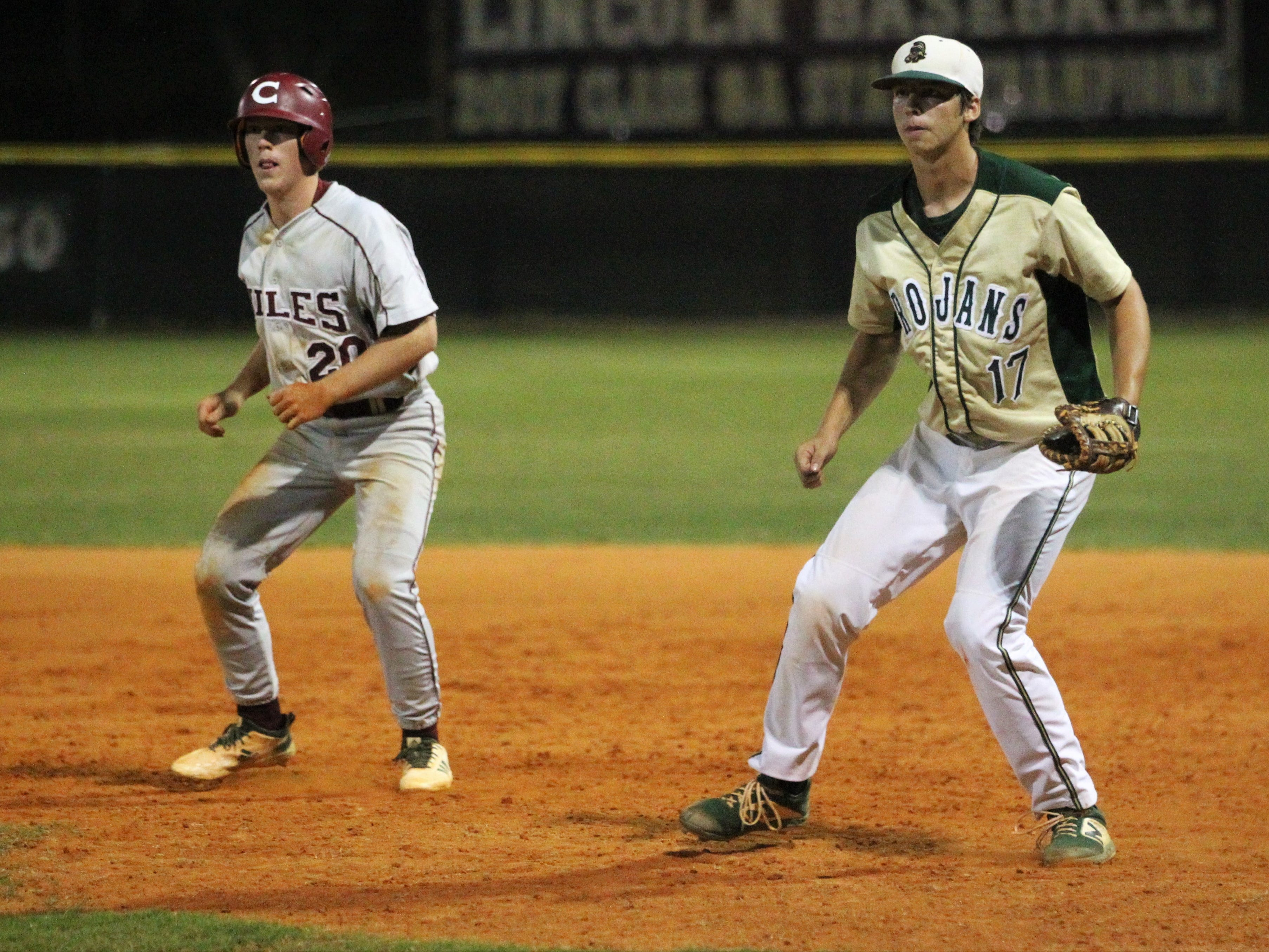 Chiles senior Mason Sanford gets a lead off first base as Lincoln first baseman Tommy Mills waits defensively as Lincoln baseball beat Chiles 5-4  in 10 innings during a District 2-8A championship game on Thursday, May 9, 2019.