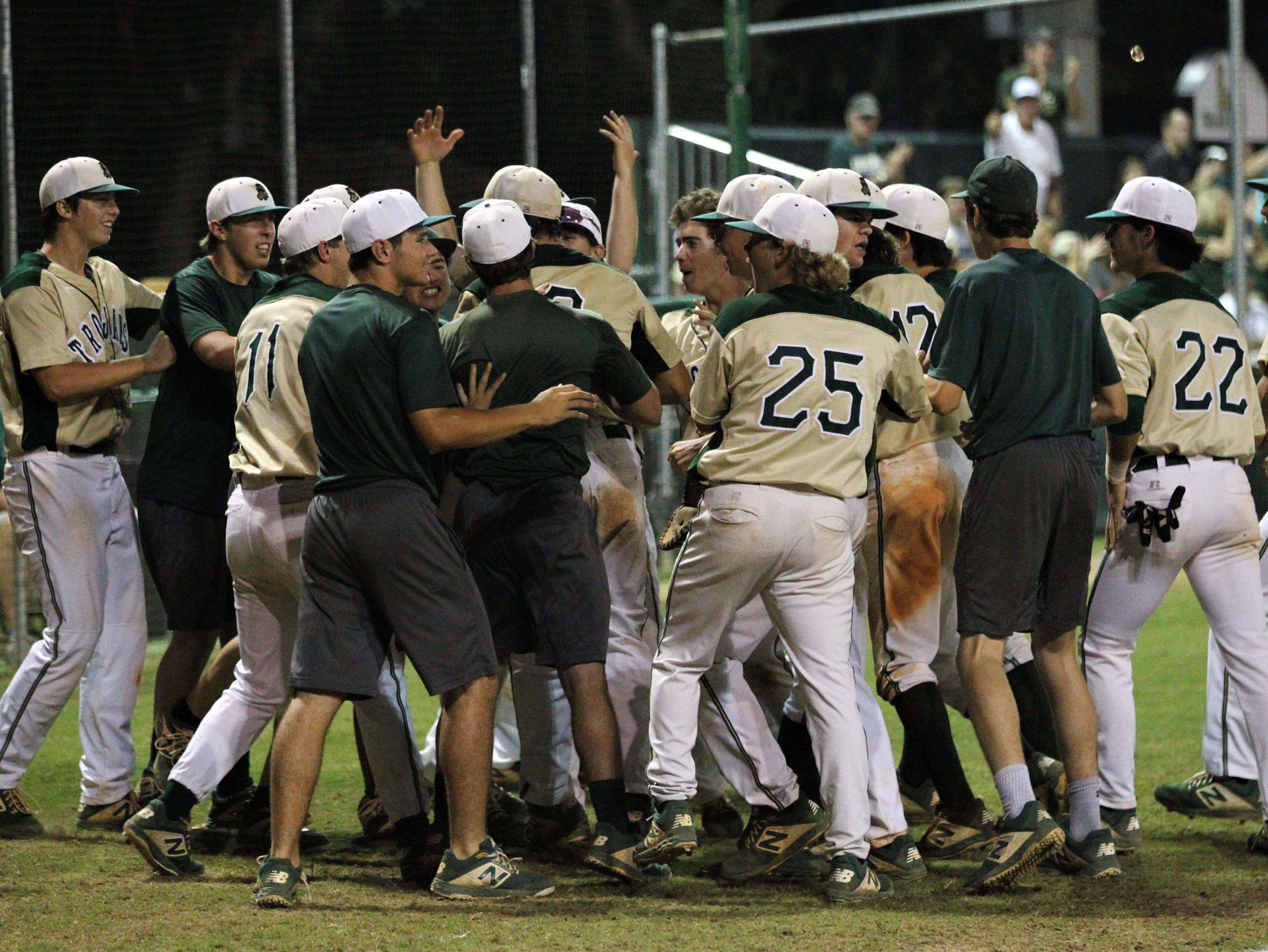 Lincoln players react after getting out of an inning as Lincoln baseball beat Chiles 5-4  in 10 innings during a District 2-8A championship game on Thursday, May 9, 2019.