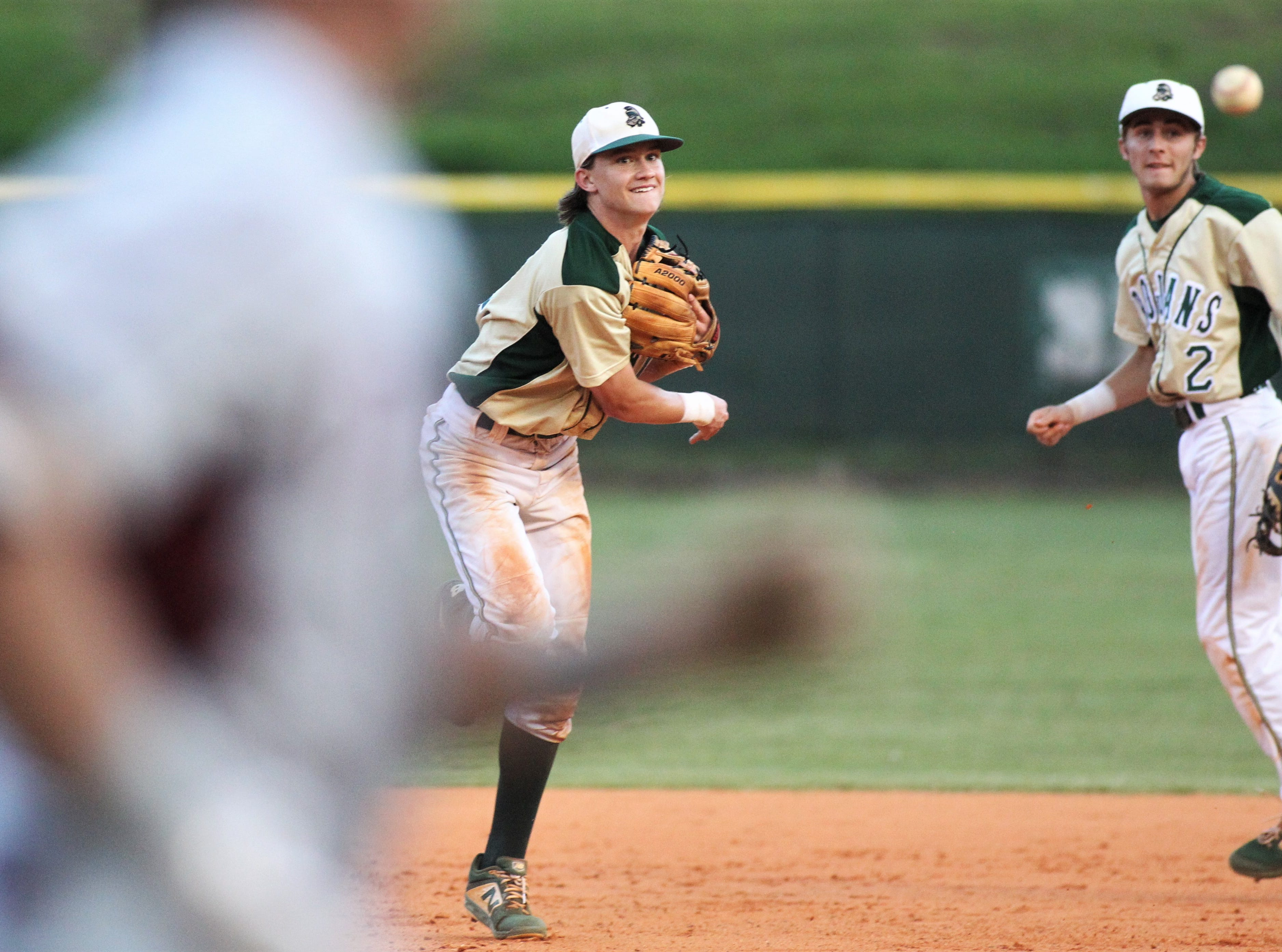 Lincoln shortstop Nick Standridge throws to first for an out as Lincoln baseball beat Chiles 5-4  in 10 innings during a District 2-8A championship game on Thursday, May 9, 2019.