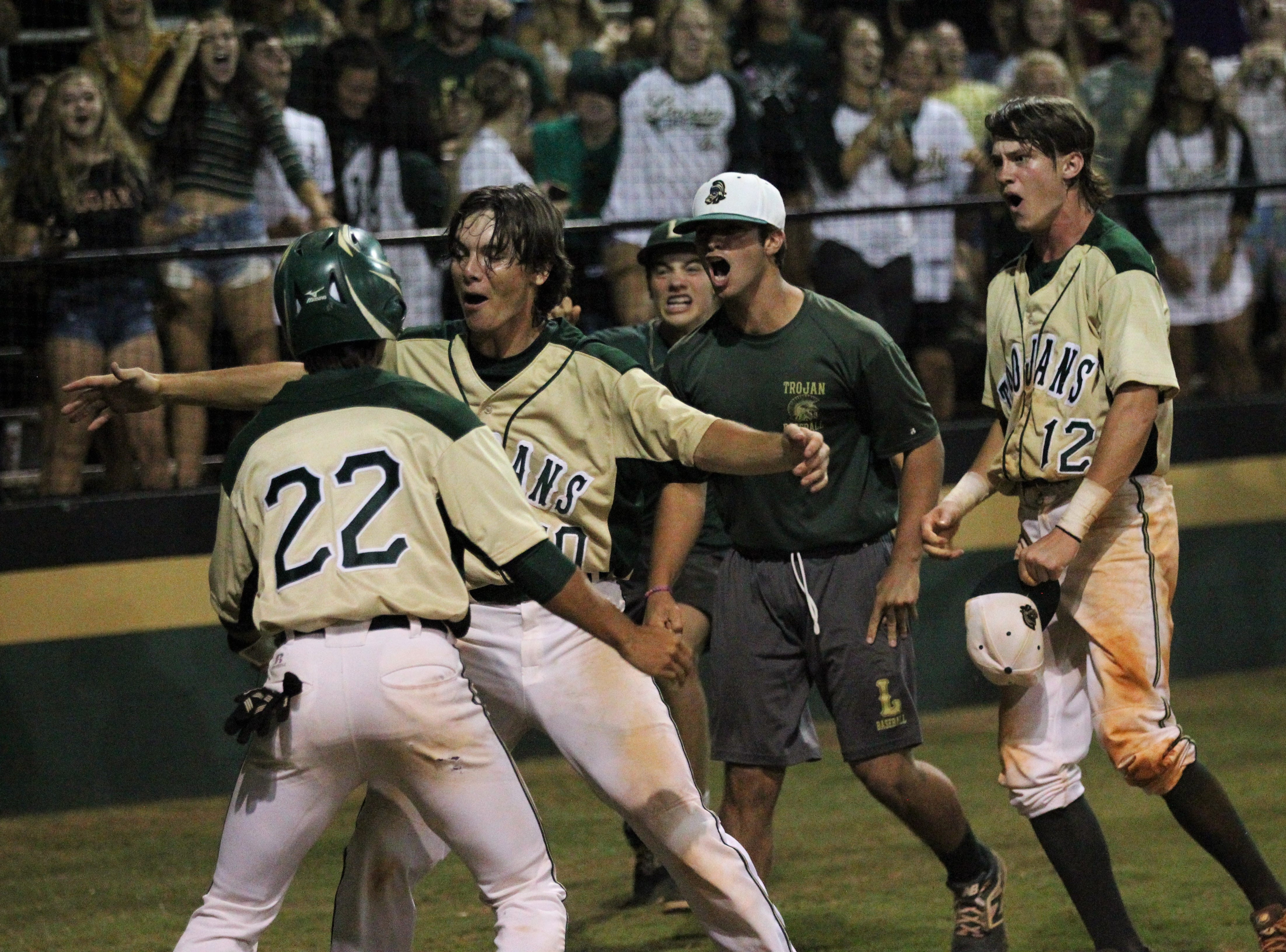 Lincoln's Connor Majors (22) scores the game-tying run in the bottom of the seventh on an error as Lincoln baseball beat Chiles 5-4  in 10 innings during a District 2-8A championship game on Thursday, May 9, 2019.