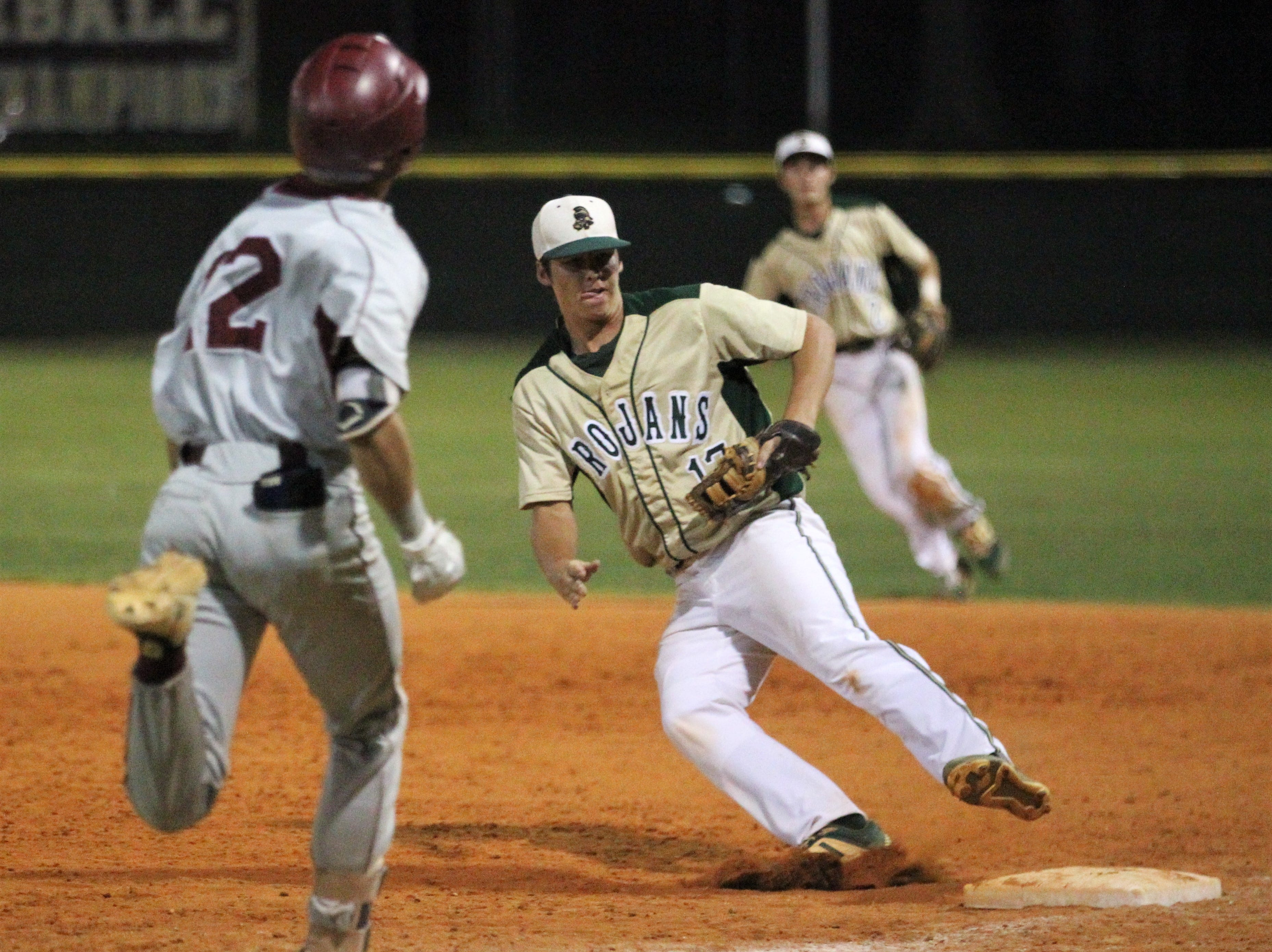Lincoln first baseman Tommy Mills steps on first for an out as Lincoln baseball beat Chiles 5-4  in 10 innings during a District 2-8A championship game on Thursday, May 9, 2019.