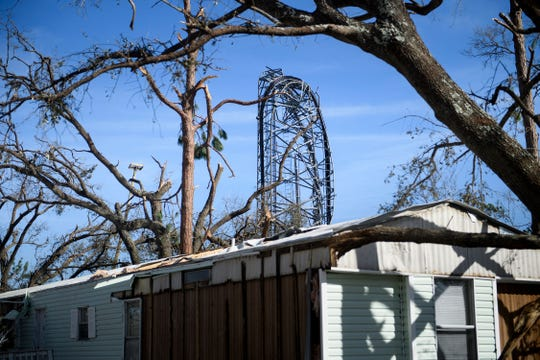A destroyed cellular tower is seen in the aftermath of Hurricane Michael on October 12, 2018 in Panama City, Florida. - Rescue teams using sniffer dogs carried out a grim search for victims of Hurricane Michael on Friday amid fears that the death toll from the monster storm, which currently stands at 11, could rise. (Photo by Brendan  BRENDAN SMIALOWSKI/AFP/Getty Images)