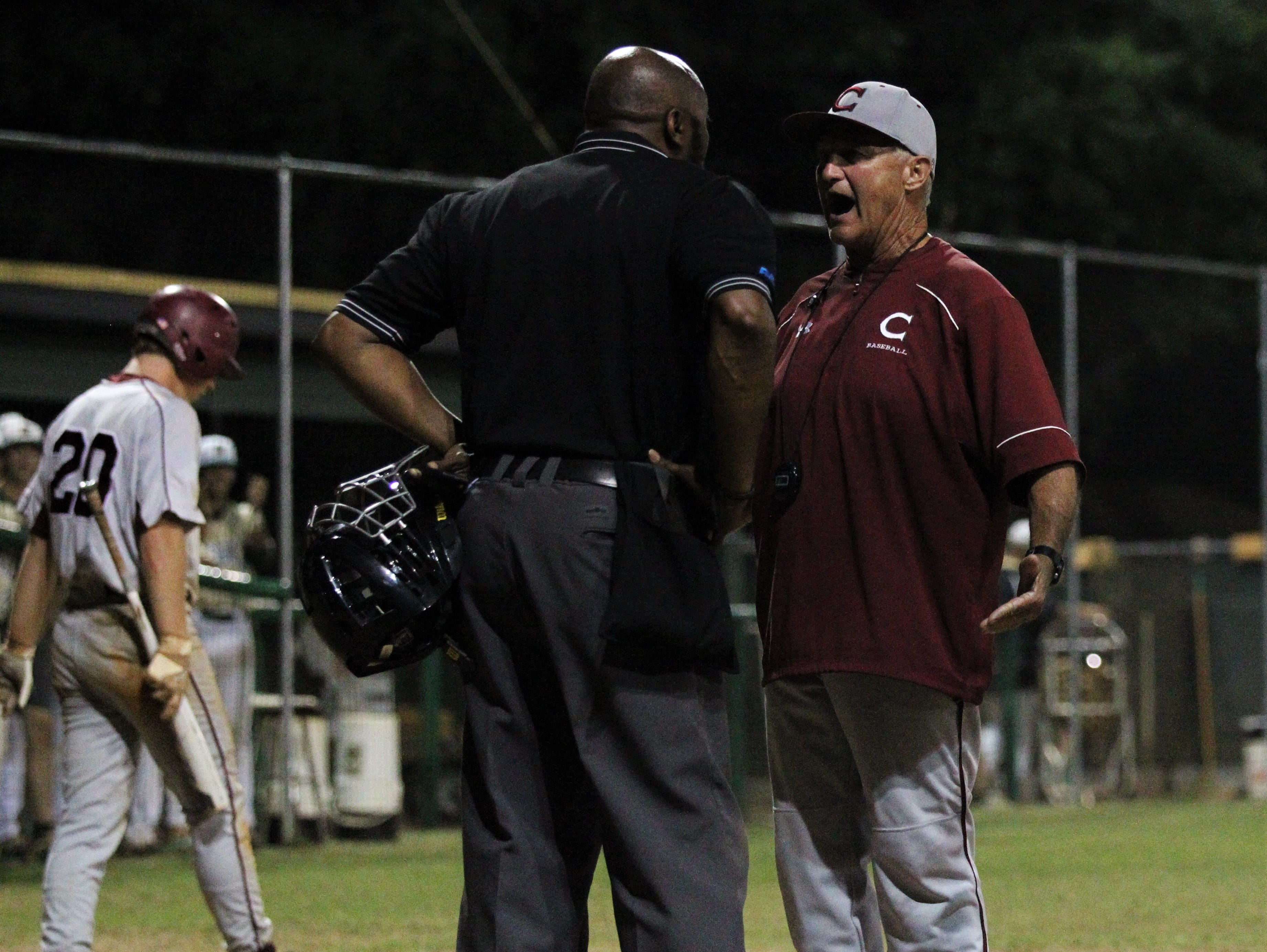 Chiles baseball coach Dick Steed argues with the home plate umpire as Lincoln baseball beat Chiles 5-4  in 10 innings during a District 2-8A championship game on Thursday, May 9, 2019.