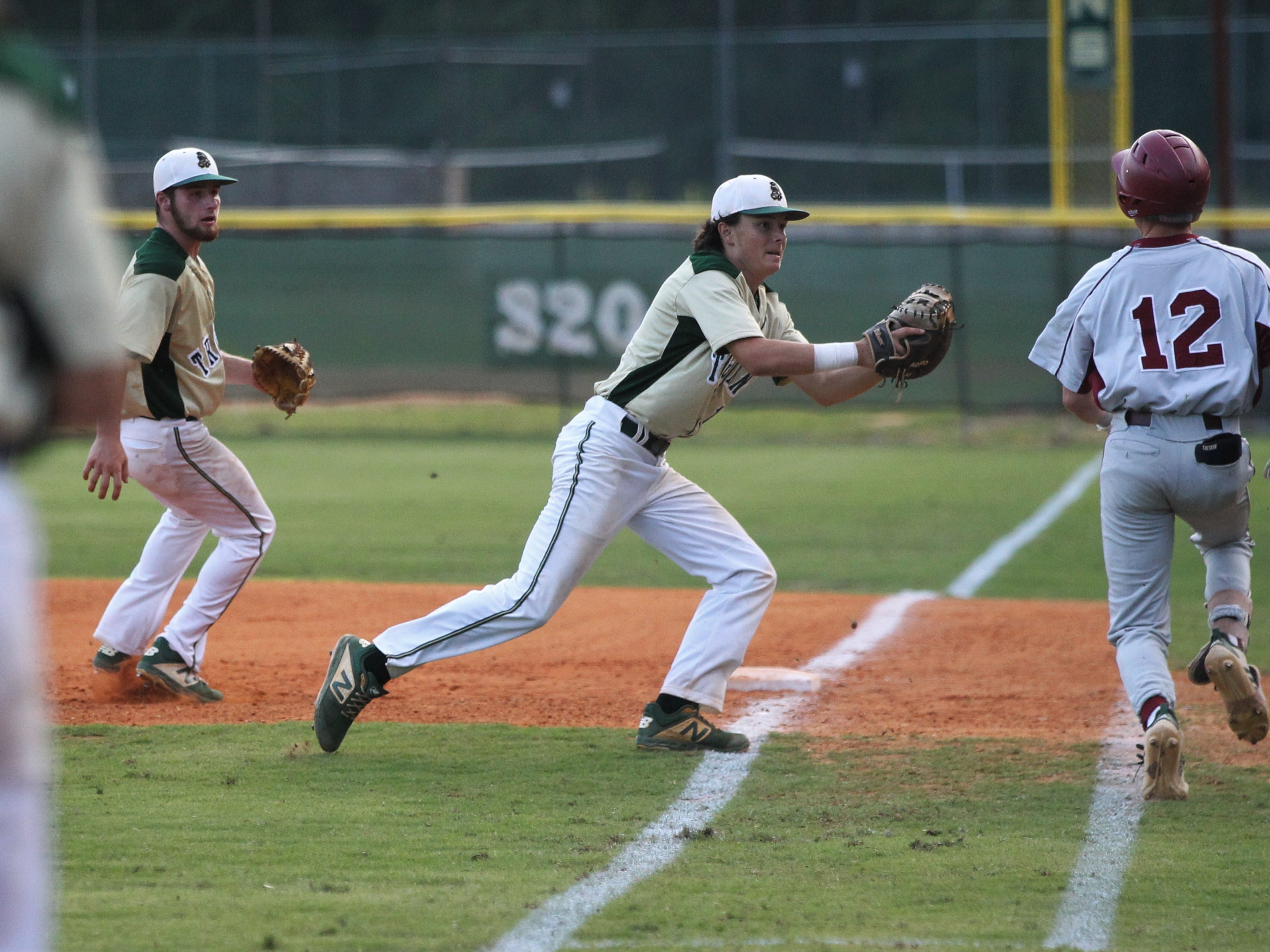 Lincoln first baseman Shawn Snyder tags out Chiles freshman Jaxson West on a grounder as Lincoln baseball beat Chiles 5-4  in 10 innings during a District 2-8A championship game on Thursday, May 9, 2019.