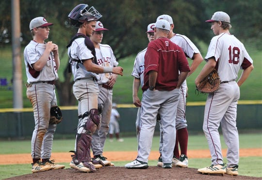 Chiles baseball coach Dick Steed has a discussion with his team as Lincoln baseball beat Chiles 5-4  in 10 innings during a District 2-8A championship game on Thursday, May 9, 2019.
