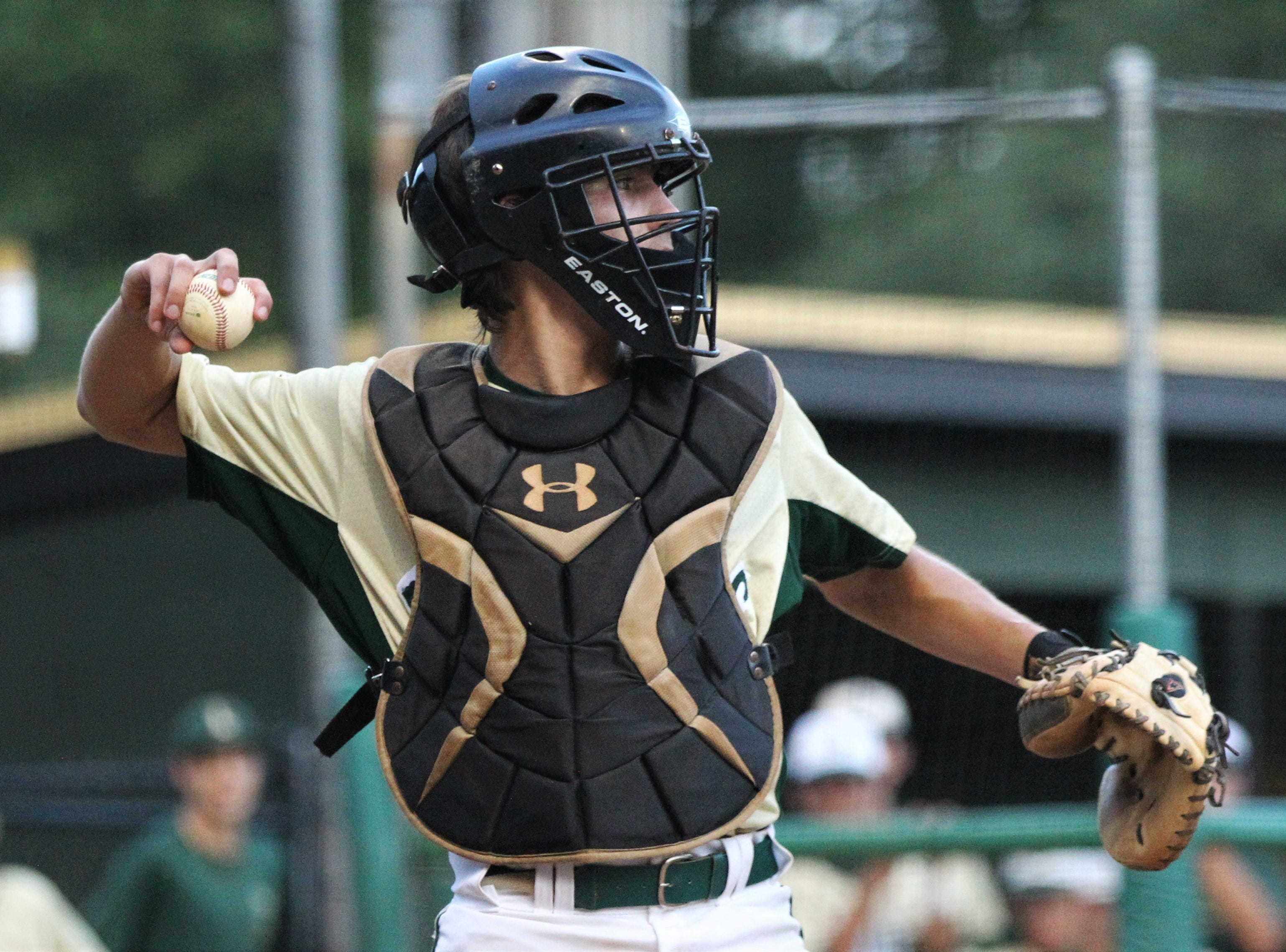 Lincoln catcher Hunter Peschl throws a ball back to the mound as Lincoln baseball beat Chiles 5-4  in 10 innings during a District 2-8A championship game on Thursday, May 9, 2019.