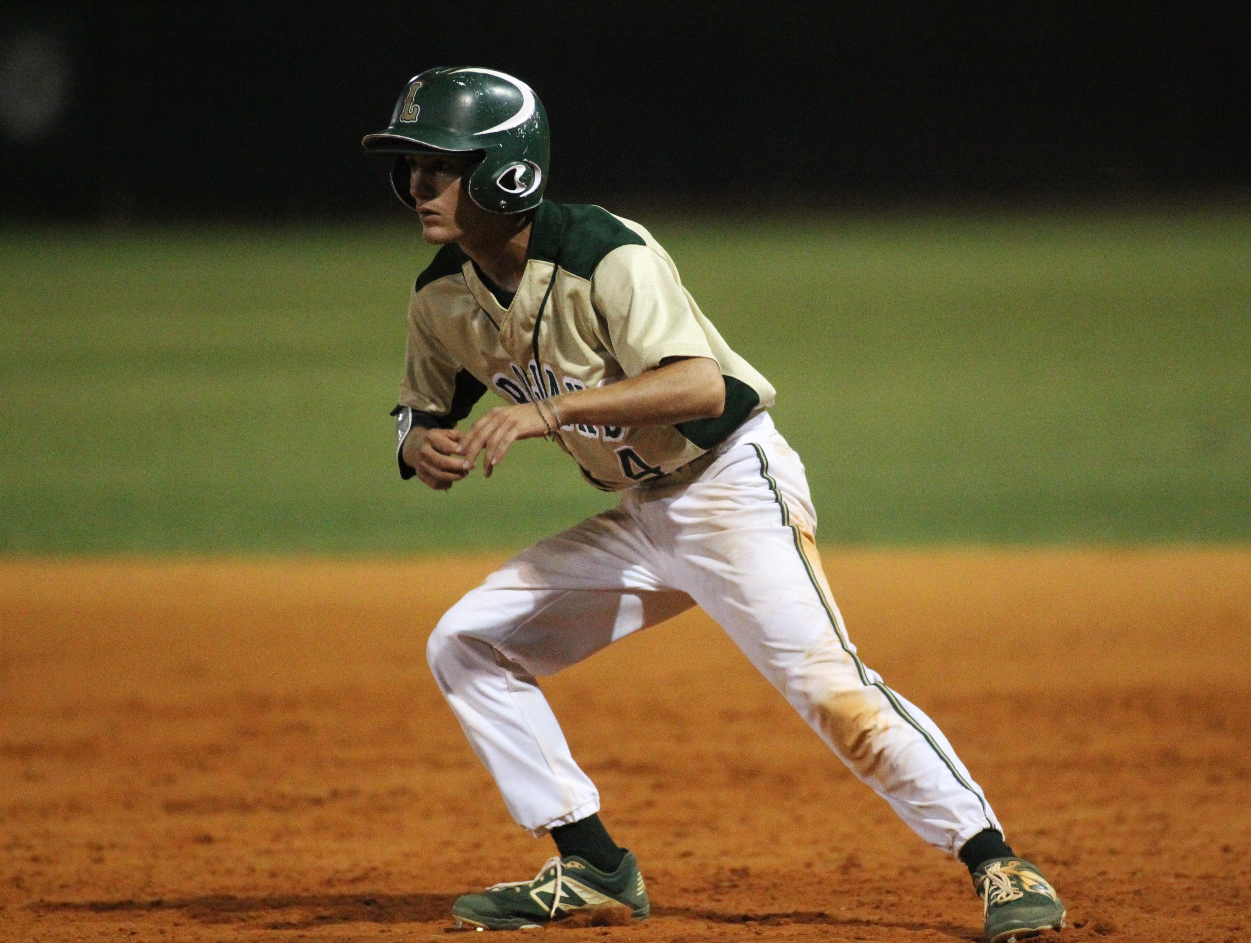 Lincoln senior Caleb Kittrell takes a lead off first base after a single as Lincoln baseball beat Chiles 5-4  in 10 innings during a District 2-8A championship game on Thursday, May 9, 2019.