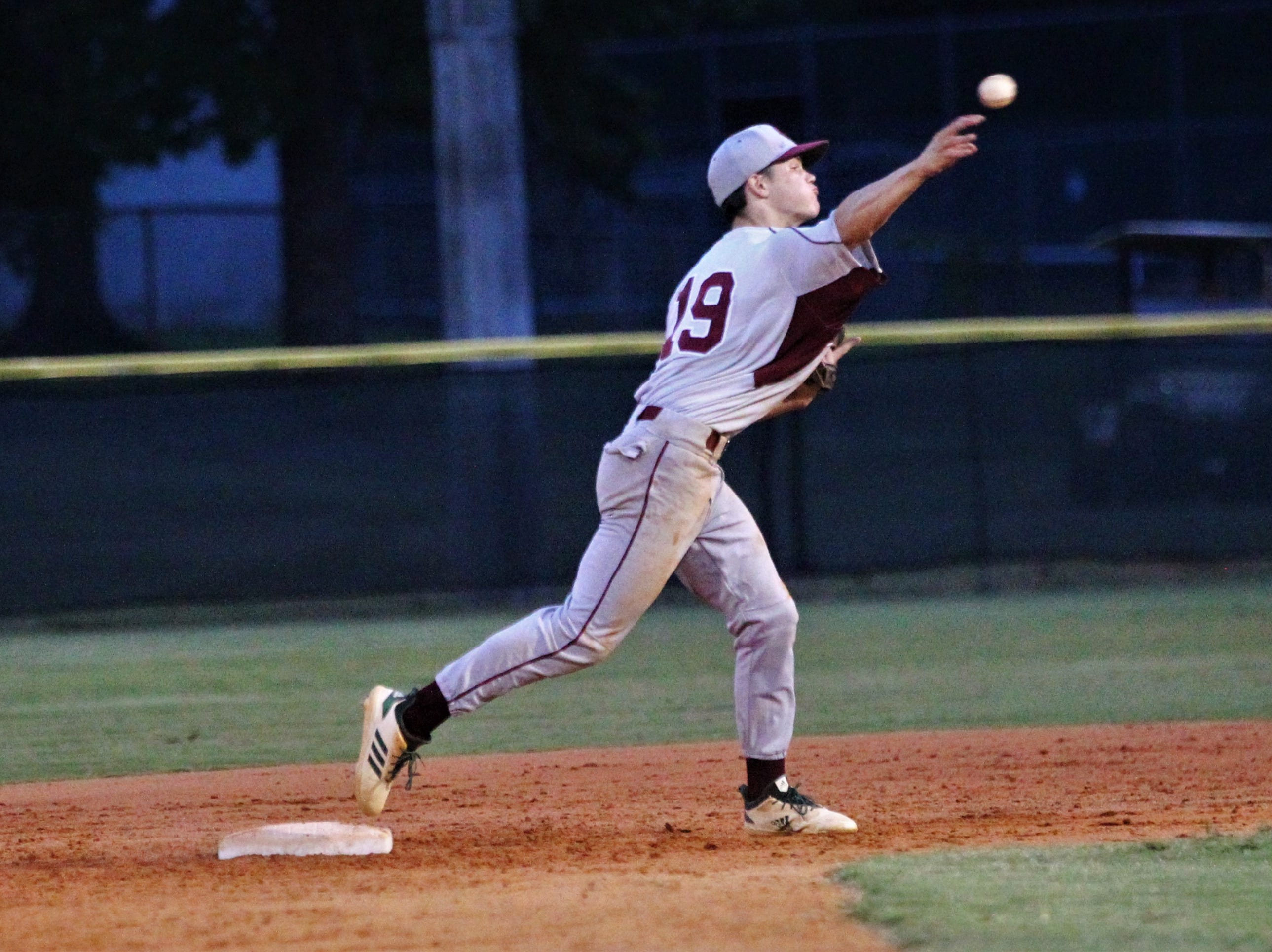 Chiles second baseman Parker McDonald throws to first as Lincoln baseball beat Chiles 5-4  in 10 innings during a District 2-8A championship game on Thursday, May 9, 2019.