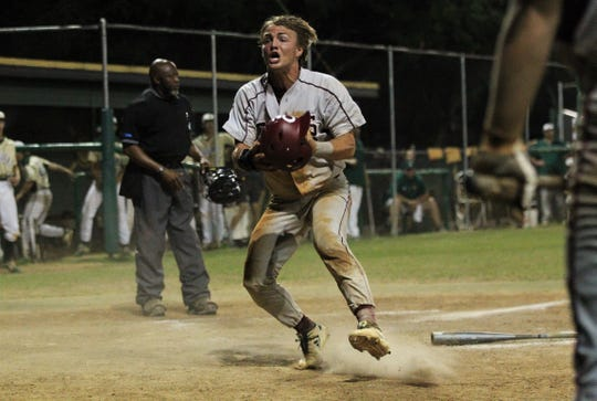 Chiles junior Garrett Greene slides in on a play at the plate in the 10th inning but was ruled to have been tagged out, much to his disagreement, resulting in a subsequent ejection as Lincoln baseball beat Chiles 5-4  in 10 innings during a District 2-8A championship game on Thursday, May 9, 2019.