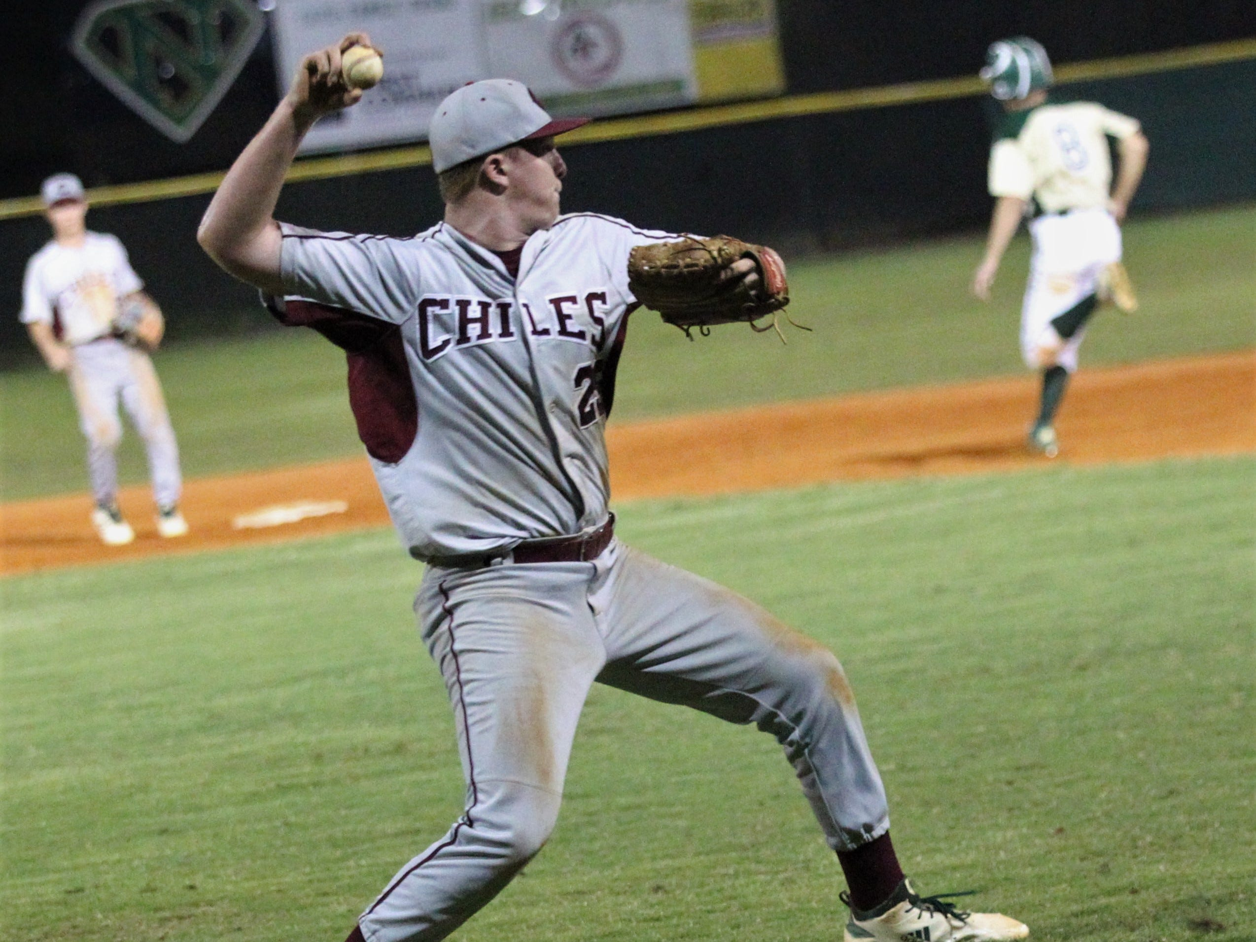 Chiles pitcher Wyatt Dodd fields his position on a bunt as Lincoln baseball beat Chiles 5-4  in 10 innings during a District 2-8A championship game on Thursday, May 9, 2019.