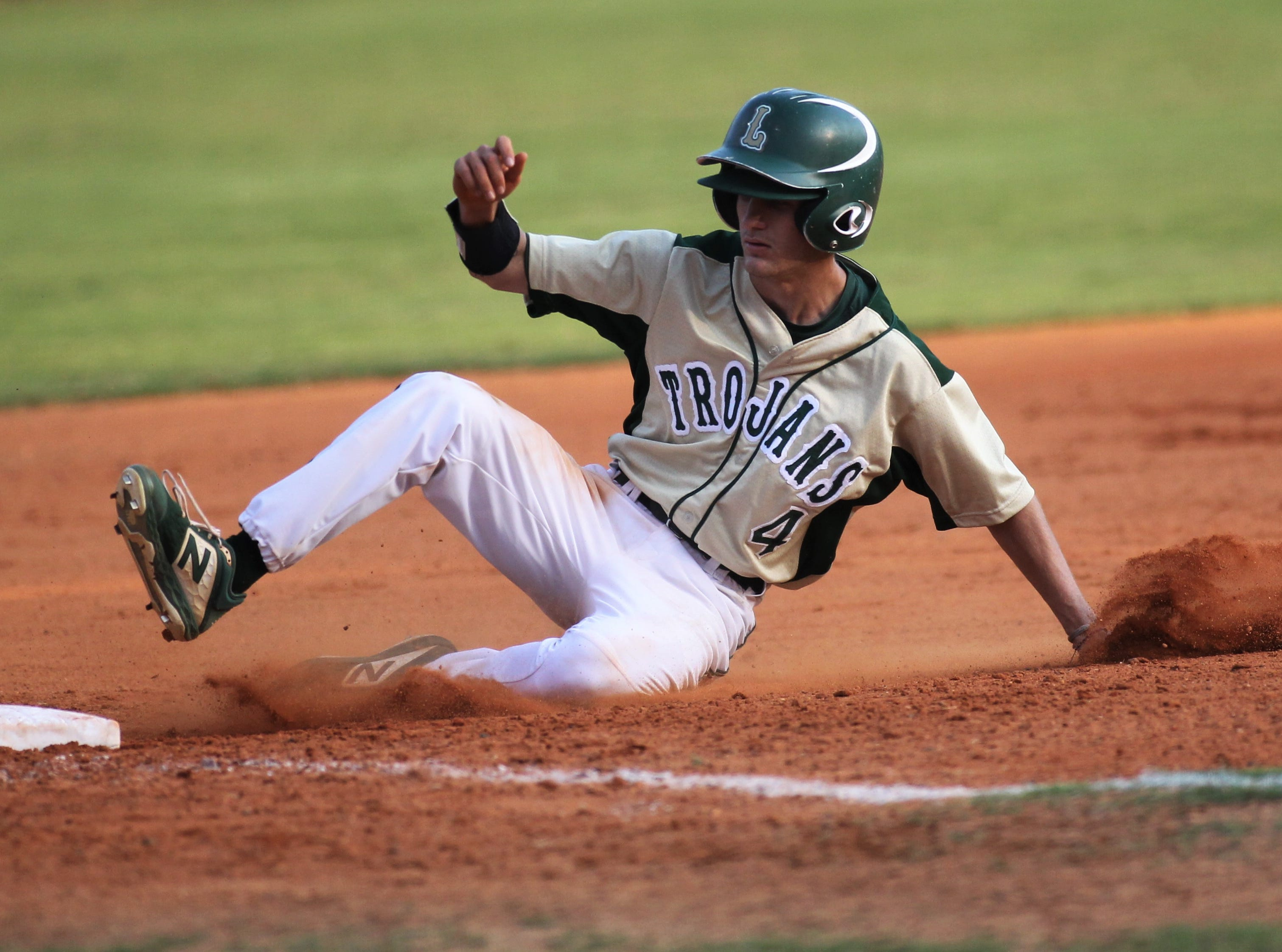 Lincoln senior Claeb Kittrell slides in safely at third base as Lincoln baseball beat Chiles 5-4  in 10 innings during a District 2-8A championship game on Thursday, May 9, 2019.