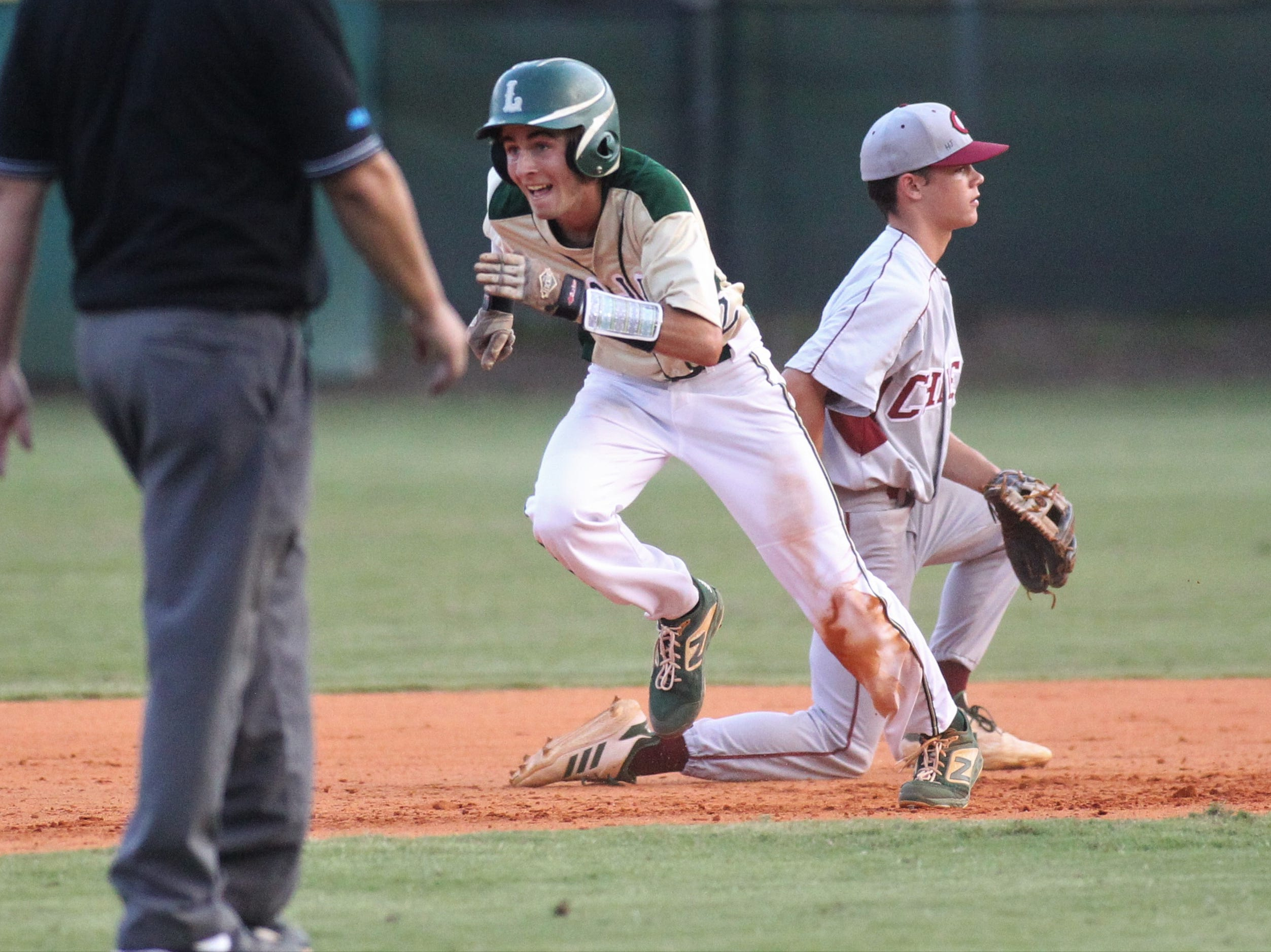 Lincoln senior Jackson White races to third after an error as Lincoln baseball beat Chiles 5-4  in 10 innings during a District 2-8A championship game on Thursday, May 9, 2019.