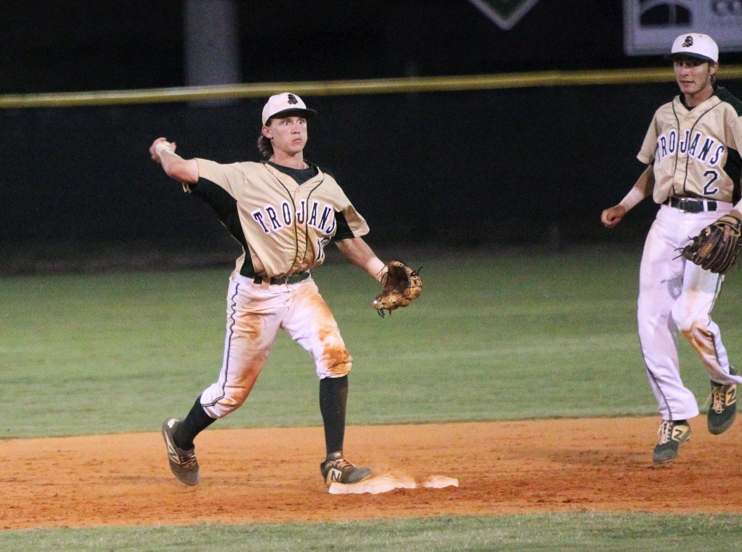 Lincoln shortstop Nick Standridge steps on second and fires to first for a double play as Lincoln baseball beat Chiles 5-4  in 10 innings during a District 2-8A championship game on Thursday, May 9, 2019.