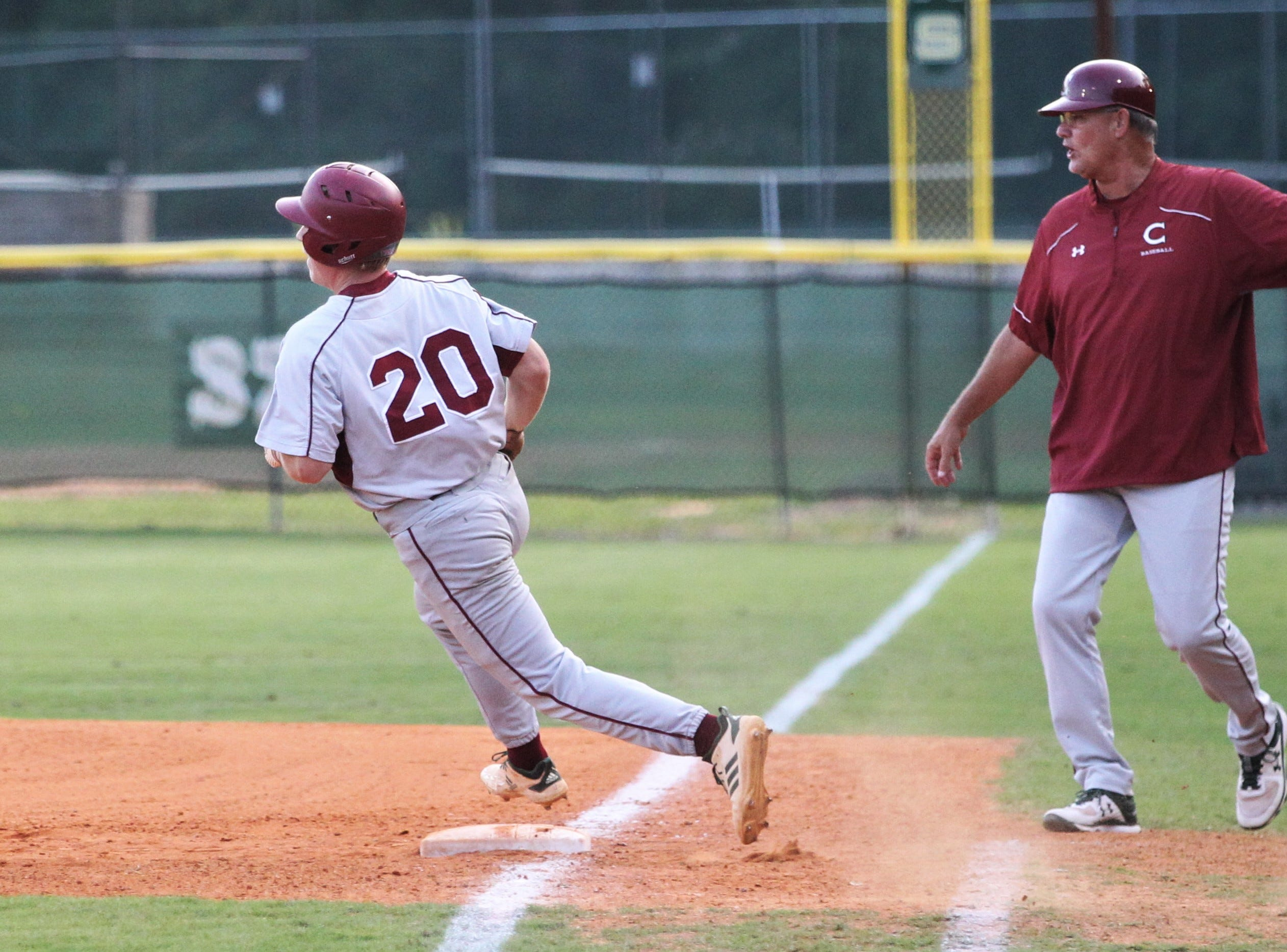 Chiles senior Mason Sanford rounds first during a double as Lincoln baseball beat Chiles 5-4  in 10 innings during a District 2-8A championship game on Thursday, May 9, 2019.
