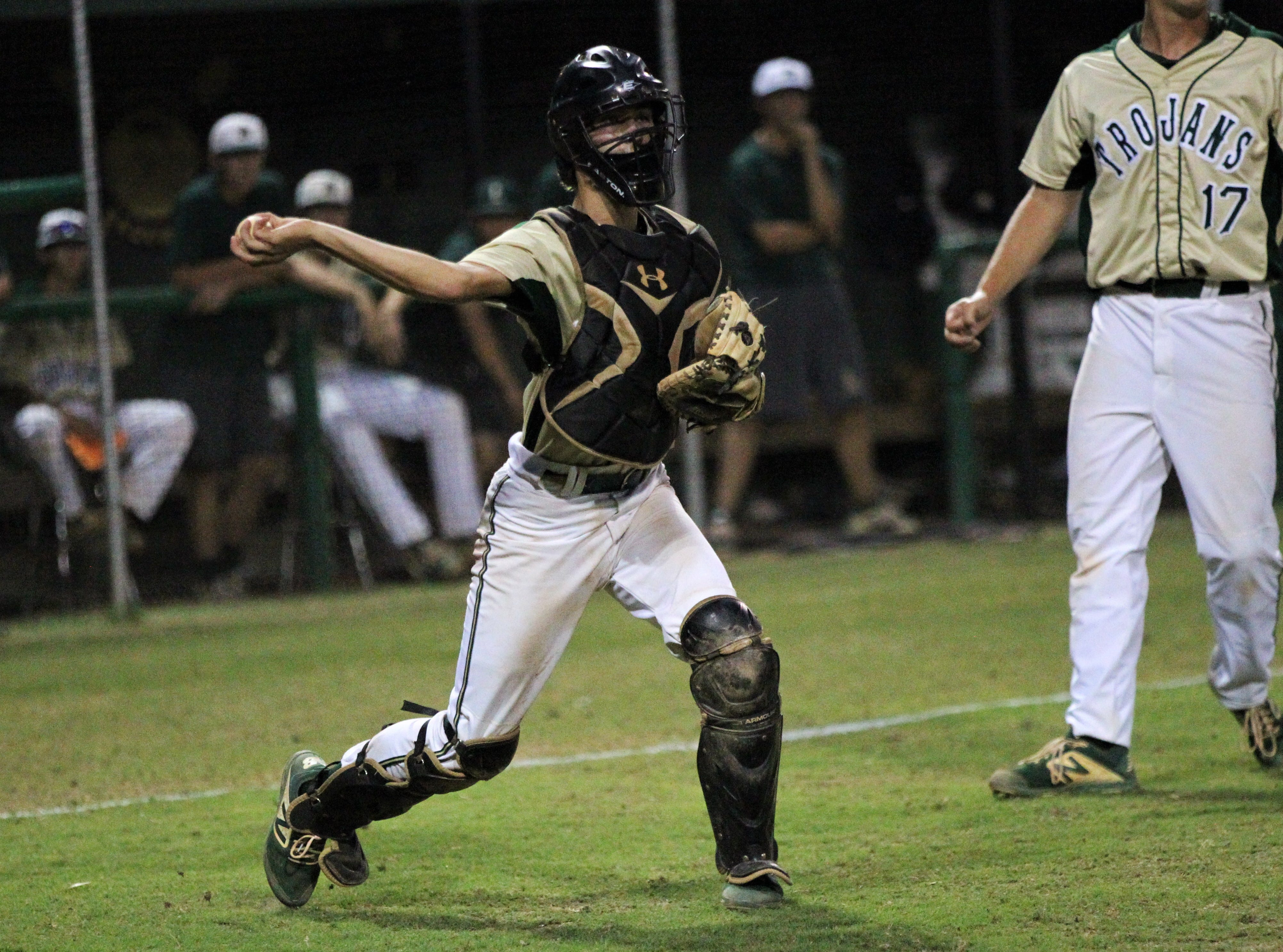 Lincoln catcher Hunter Peschl throws to first on a bunt as Lincoln baseball beat Chiles 5-4  in 10 innings during a District 2-8A championship game on Thursday, May 9, 2019.
