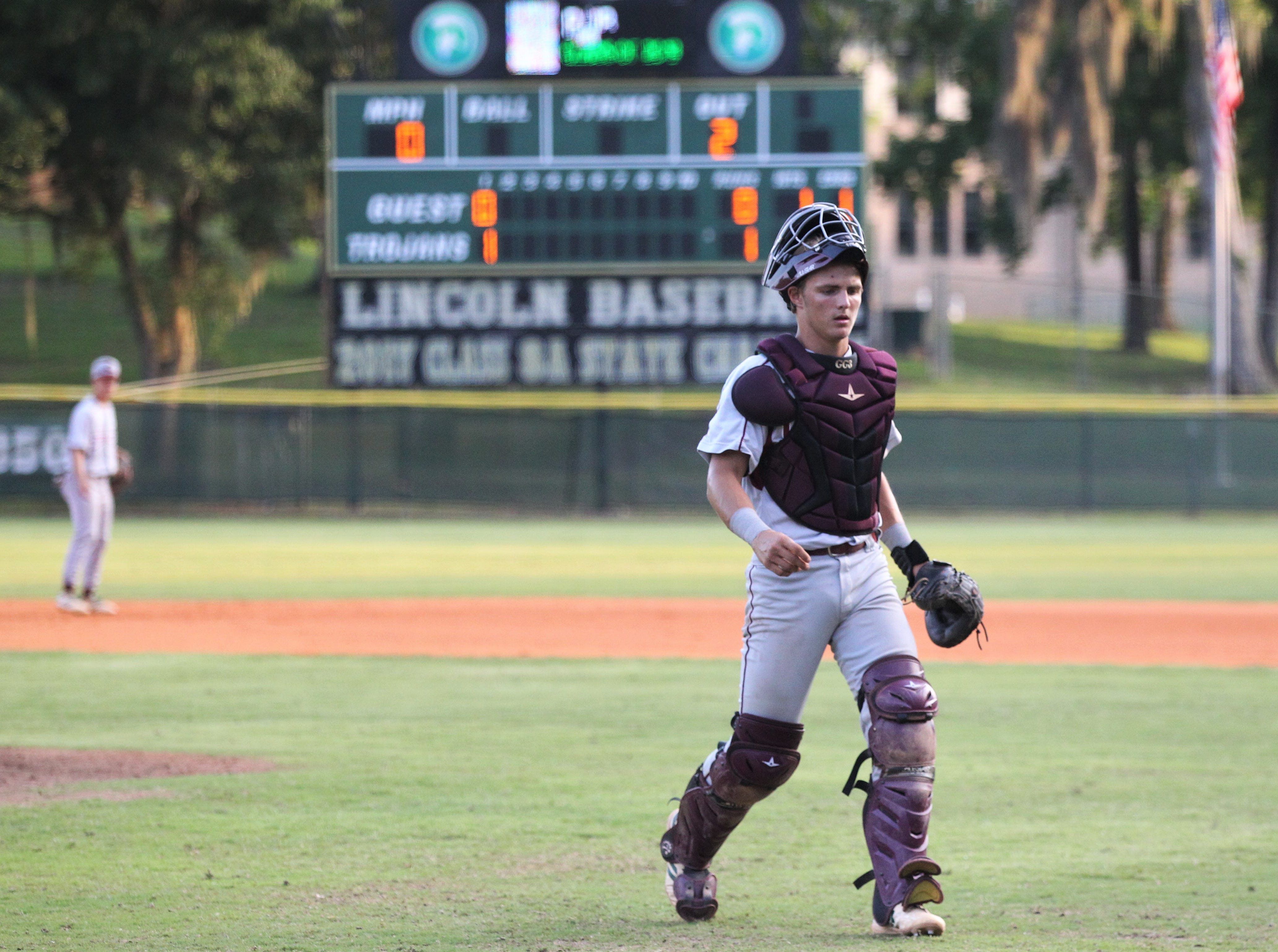 Chiles catcher Garrett Greene heads back to home plate after a discussion on the mound as Lincoln baseball beat Chiles 5-4  in 10 innings during a District 2-8A championship game on Thursday, May 9, 2019.
