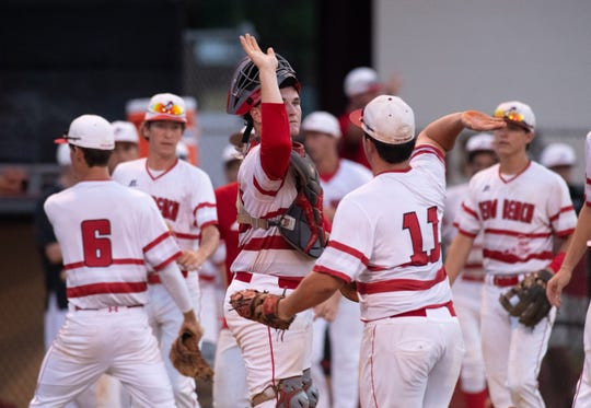 Vero Beach's catcher Matt Vaughn (center) celebrates with teammate CJ Auger in the third inning of their district 7-9A high school baseball championship game against Treasure Coast on Thursday, May 9, 2019, at Vero Beach High School.