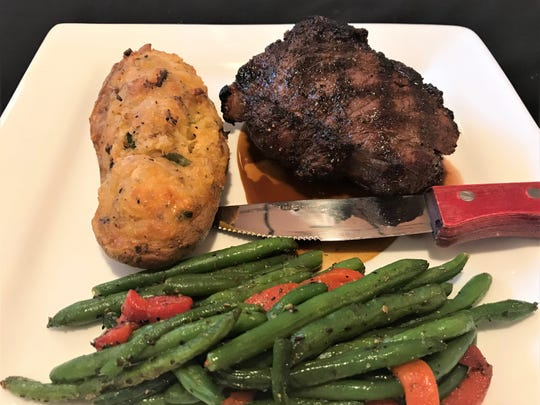 Buffalo Chophouse's Bison NY steak was a mighty 10-ounce hunk of perfectly cooked, delicious, tender meat.