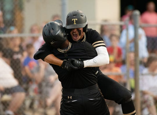 Treasure Coast's Raynel Ortiz (left) and TJ Curd celebrate after Ortiz brought in a run in the third inning of their district 7-9A high school baseball championship game against Vero Beach on Thursday, May 9, 2019, at Vero Beach High School .
