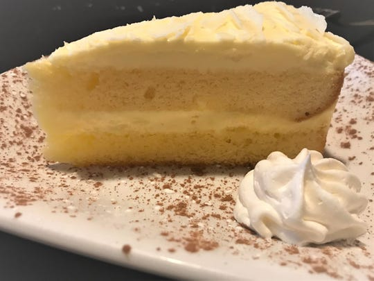 Buffalo Chophouse's Limoncello cake had a thick layer of tangy, lemony, buttercream frosting garnished with white chocolate shavings.