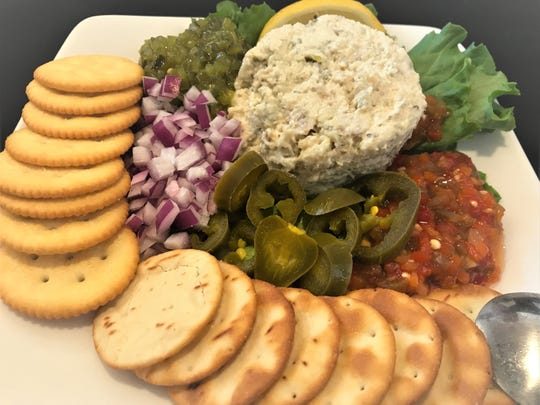 Buffalo Chophouse's mahi dip platter had chunky smoky pieces of fish alongside relishes, jalapeno, and chopped red onion.