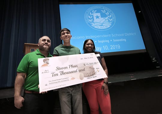 Montwood senior Steven Phan was the first recipient of a scholarship from The Great Khalid Foundation on Friday, May 10, 2019, Phan, center, is presented with his scholarship flanked by Khalid's mother, Linda Wolfe and Montwood High School Principal Carlos Guerra. Three scholarships were presented to high school students across the Socorro Independent School District.