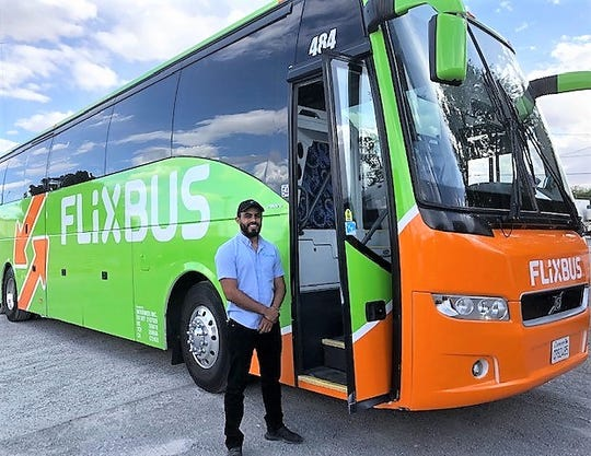 Edgar Casillas, president and owner of Intermex Transportation, stands in front of one of his company's charter buses that will serve the El Paso-Phoenix route launched by Europe-based FlixBus, a low-fare, long-distance bus service which entered the United States market a year ago.