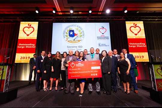 Socorro Independent School District officials accept a $100,000 reward for winning the 2019 H-E-B Excellence in Education award in the large school district category.