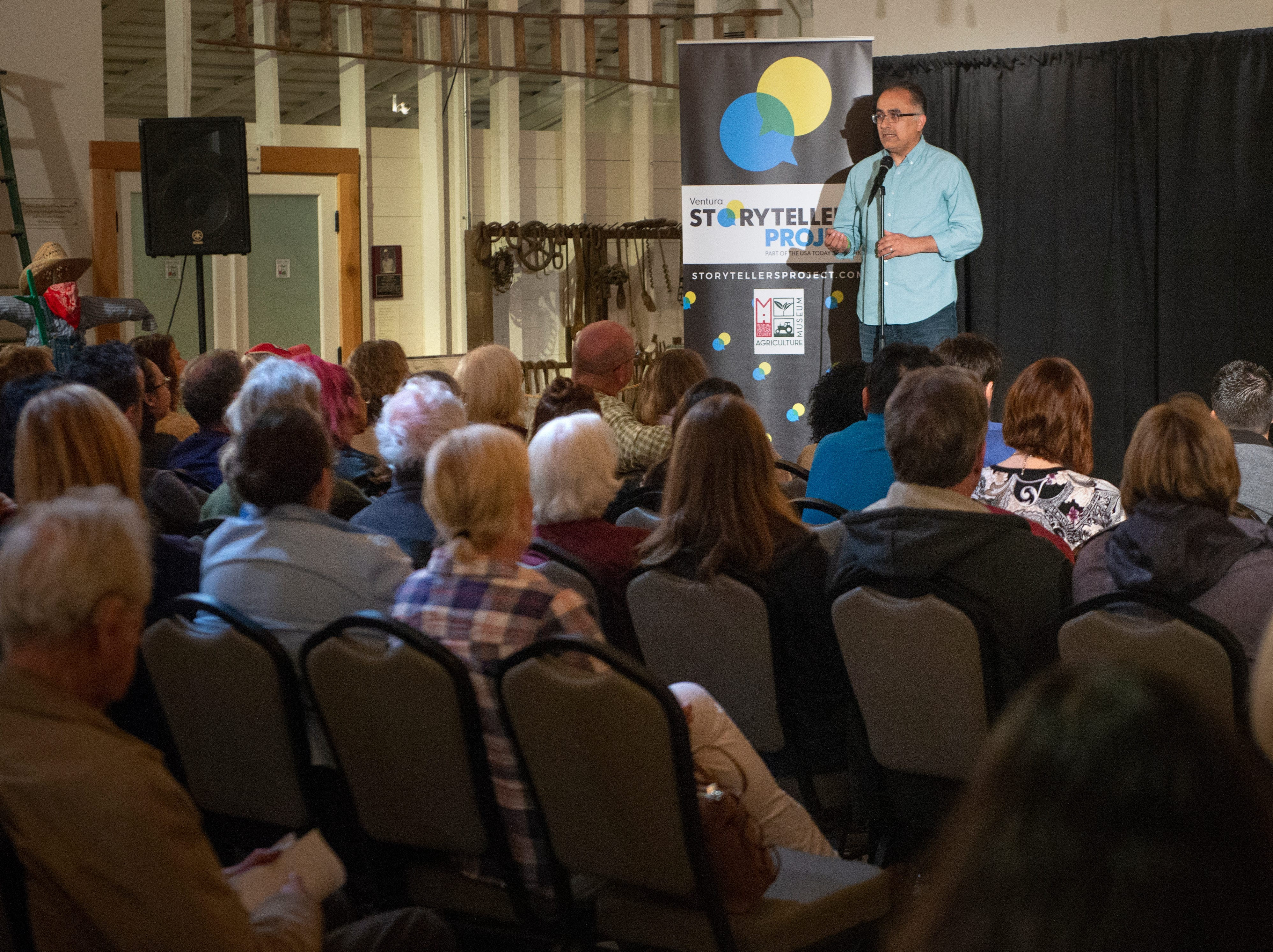 """Daniel Sandoval shares his story of raising a child with special needs during the Ventura Storytellers Project event at the Museum of Ventura County Agriculture Museum on Thursday. The theme of the night was """"Away We Go."""""""