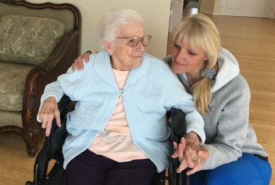 Evelyn Hudson of Ventura, one of the oldest Thomas Fire evacuees, shares a moment with her caregiver Asta Juciene in the rebuilt Crestview Villa II. The centenarian returned last month to Crestview, which had been destroyed in the 2017 blaze.